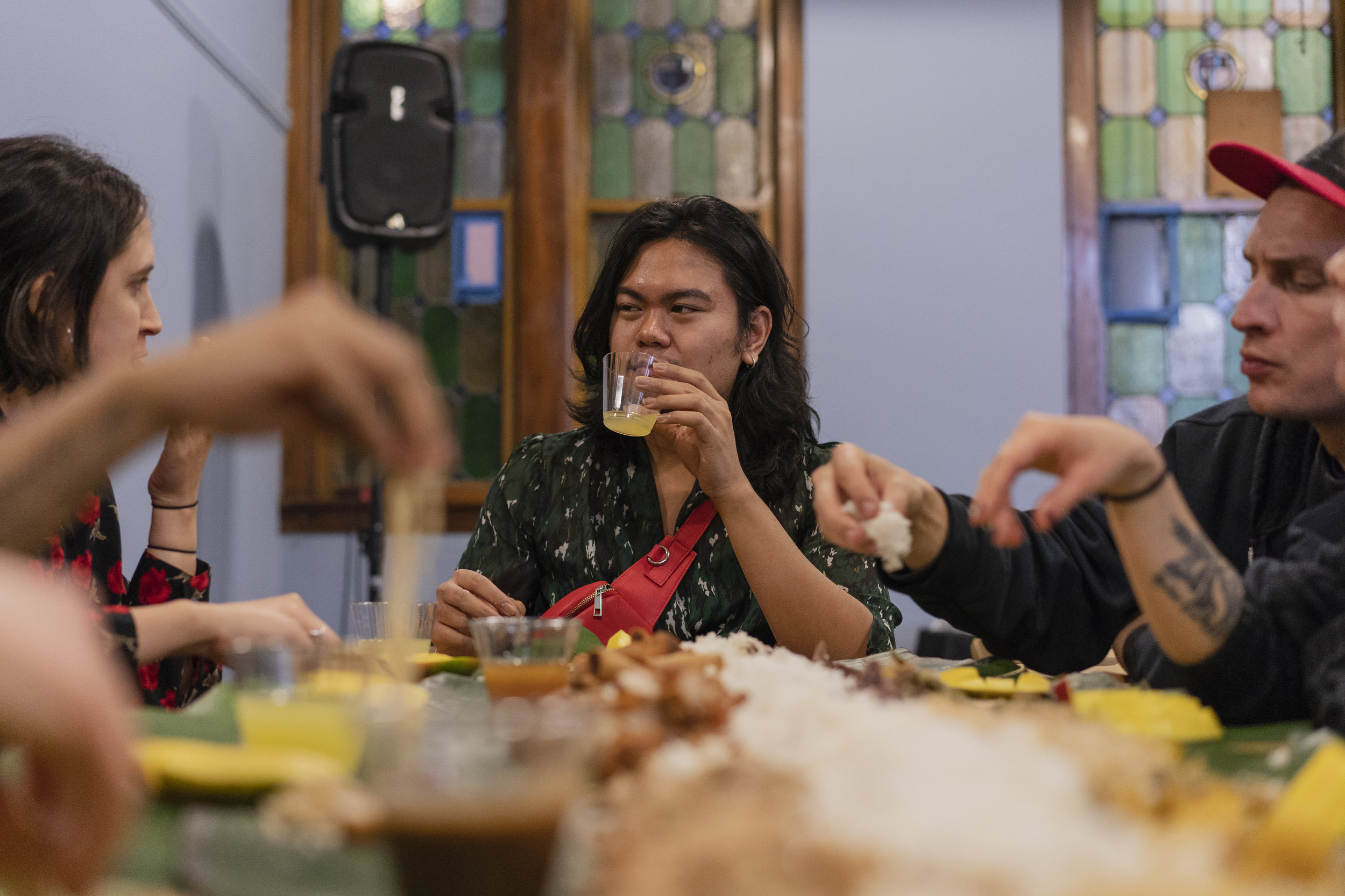 Jerico Domingo chats with attendees. A member of Export Quality Collective was seated at each table to facilitate conversations.  Photo By: Pat Nabong
