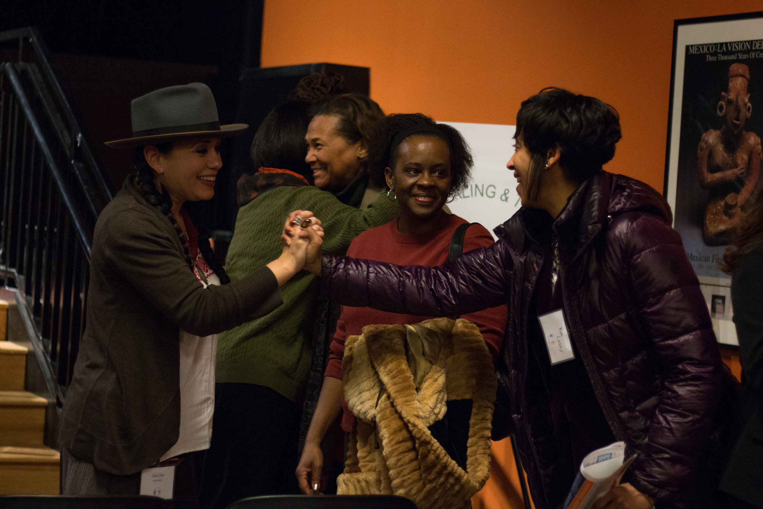Members of TRHT Greater Chicago embracing one another after weeks of workshopping.  Photos courtesy of Qurissy Lopez, Free Spirit Pro