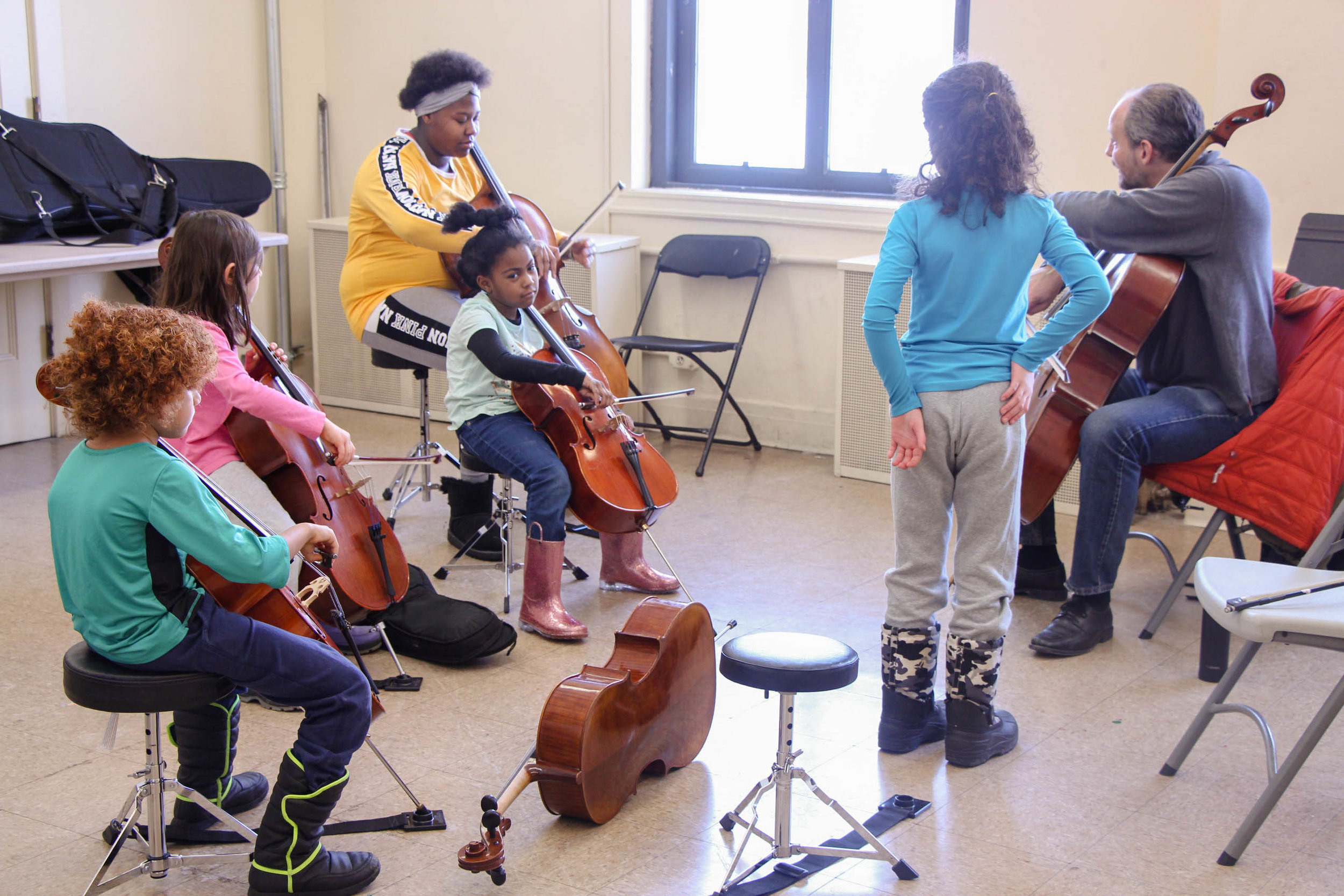 Chicago West students in a W.I.S.H. cello class