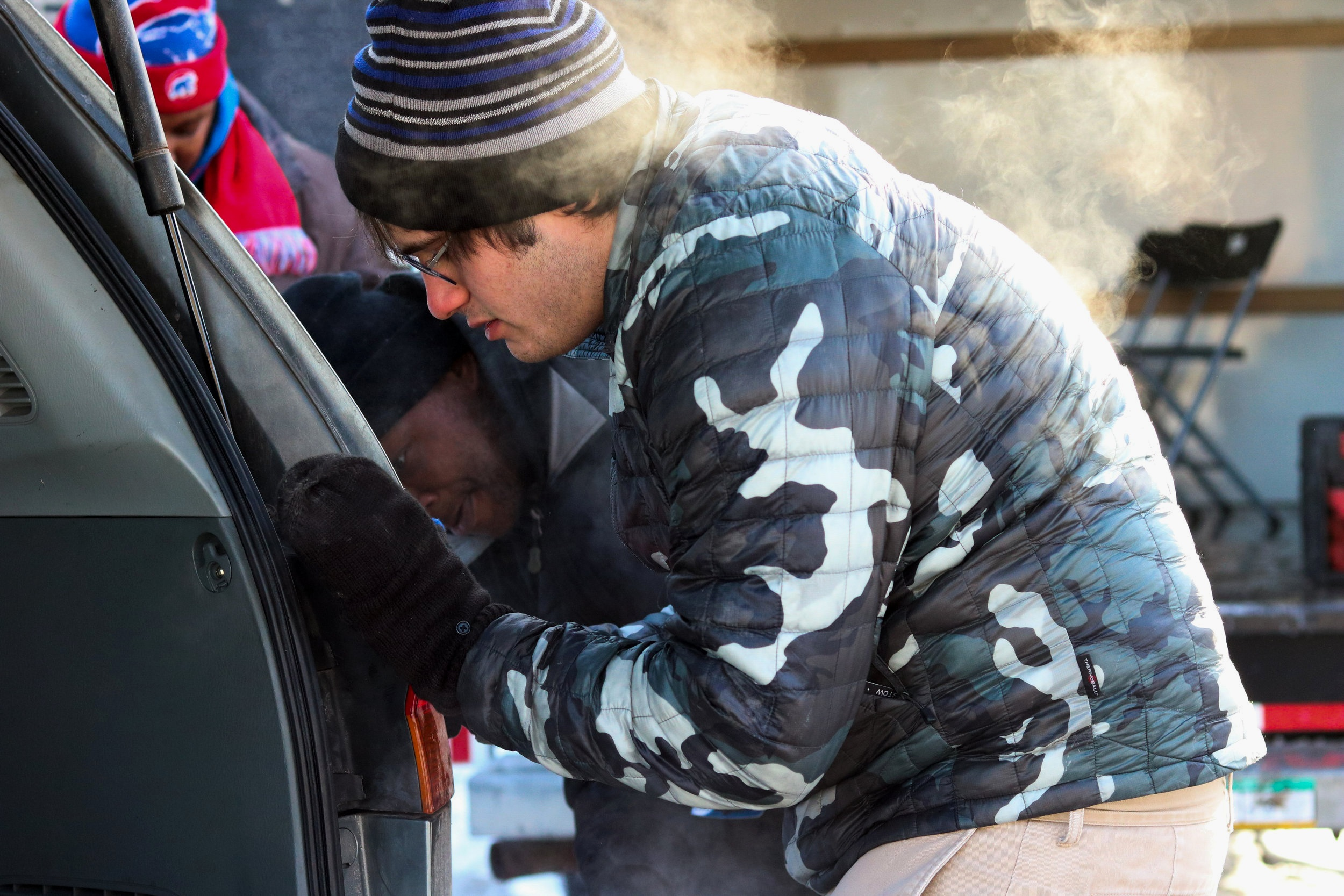 Volunteers helped community members make various repairs on their vehicles.