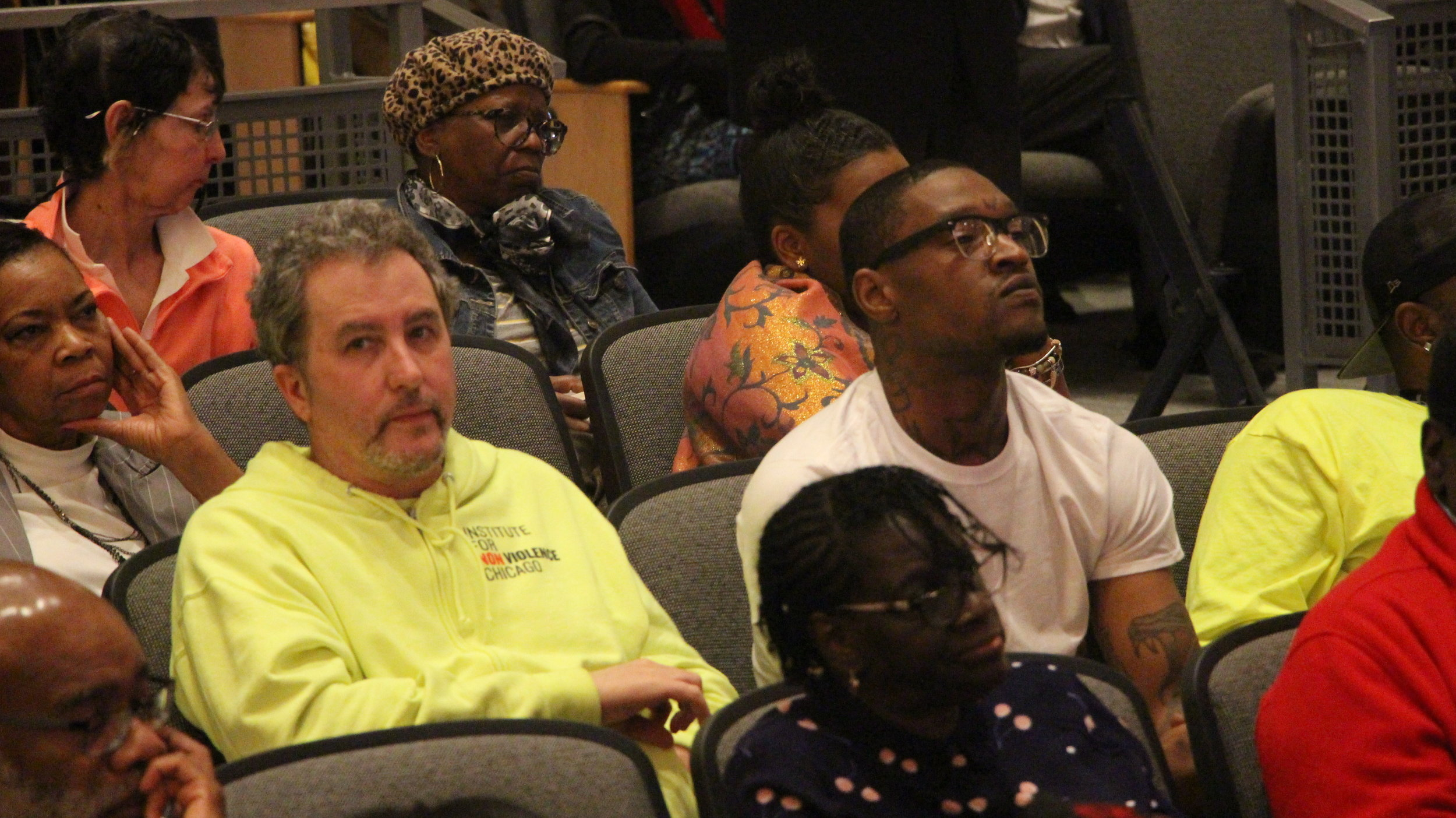 Audience members look on