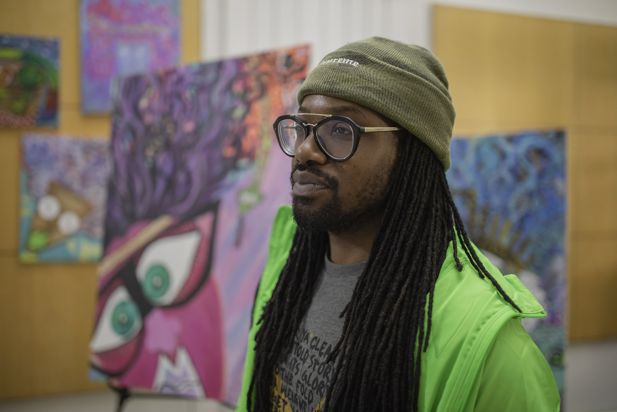"Brandon Love is an artist and teacher at the Dvorak School of Excellence. Love said his bright and colorful style is inspired by his belief that ""Black people come from the sun … that we [are] just descendants from the sun."""
