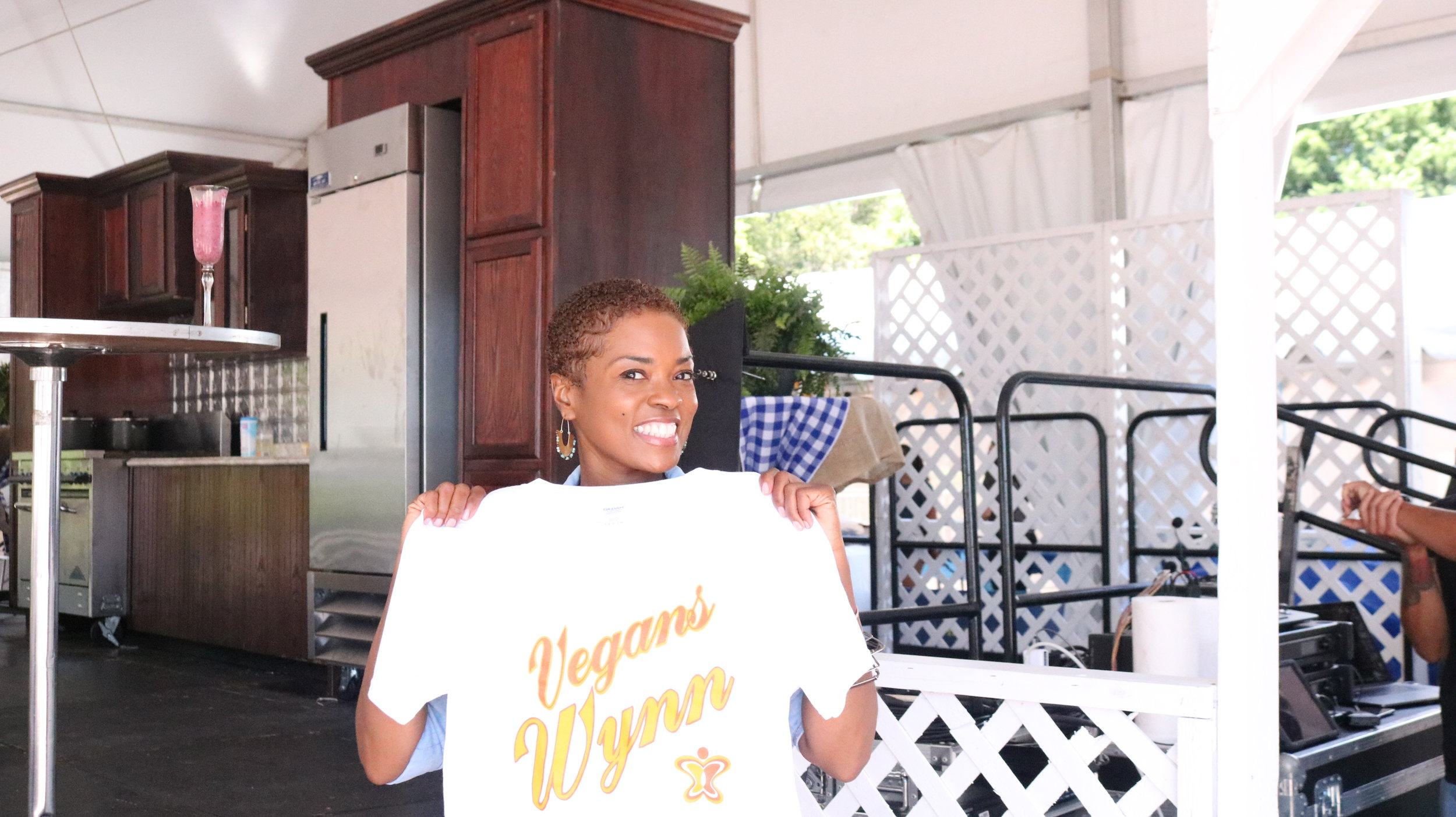 "Maisha Wynn, June 12, 2019, holding up a shirt with the label ""Vegans Wynn,"" showing her pride towards veganism and the lifestyle she chose to follow. Photo by Estefania Navarrete"
