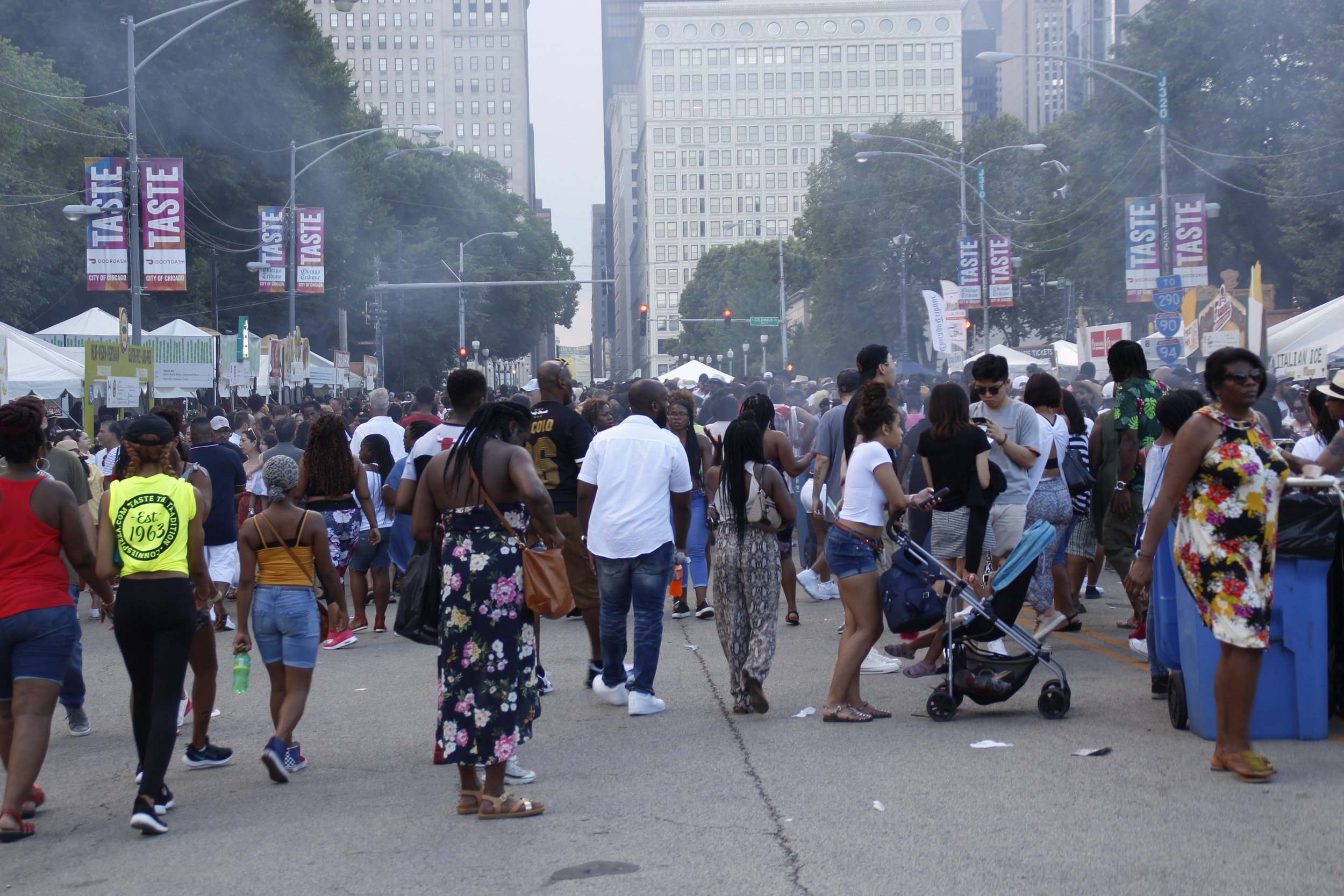 Diverse crowds swarmed the streets at the 39th annual Taste of Chicago. Chicago Police Department projected 1.6 million people visited this year.