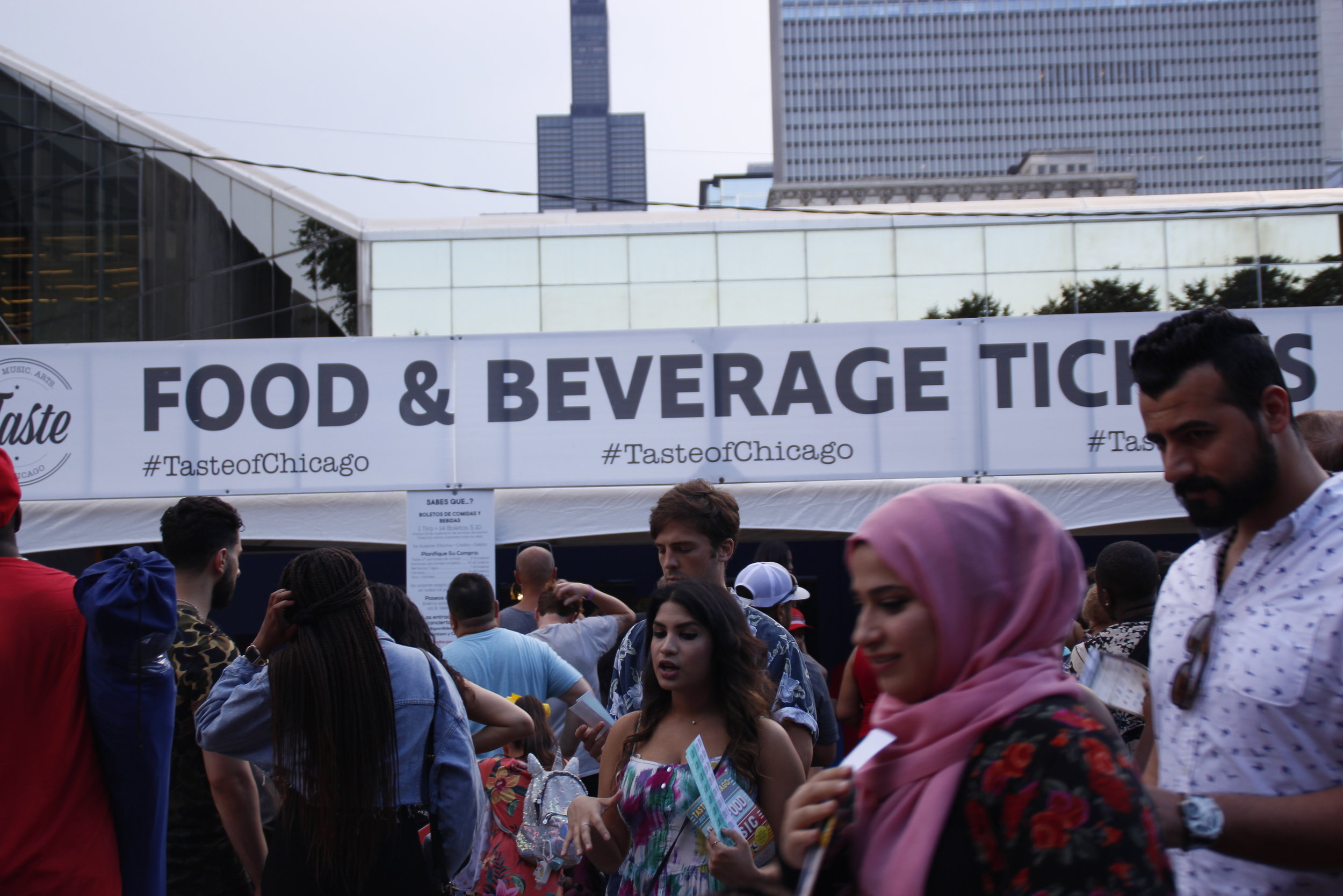 People pushed through crowds and stood in long lines to grab tickets for food at the 2019 Taste of Chicago. Tickets were $14 per strip, which included 10 tickets that could be used in exchange for sample size food.