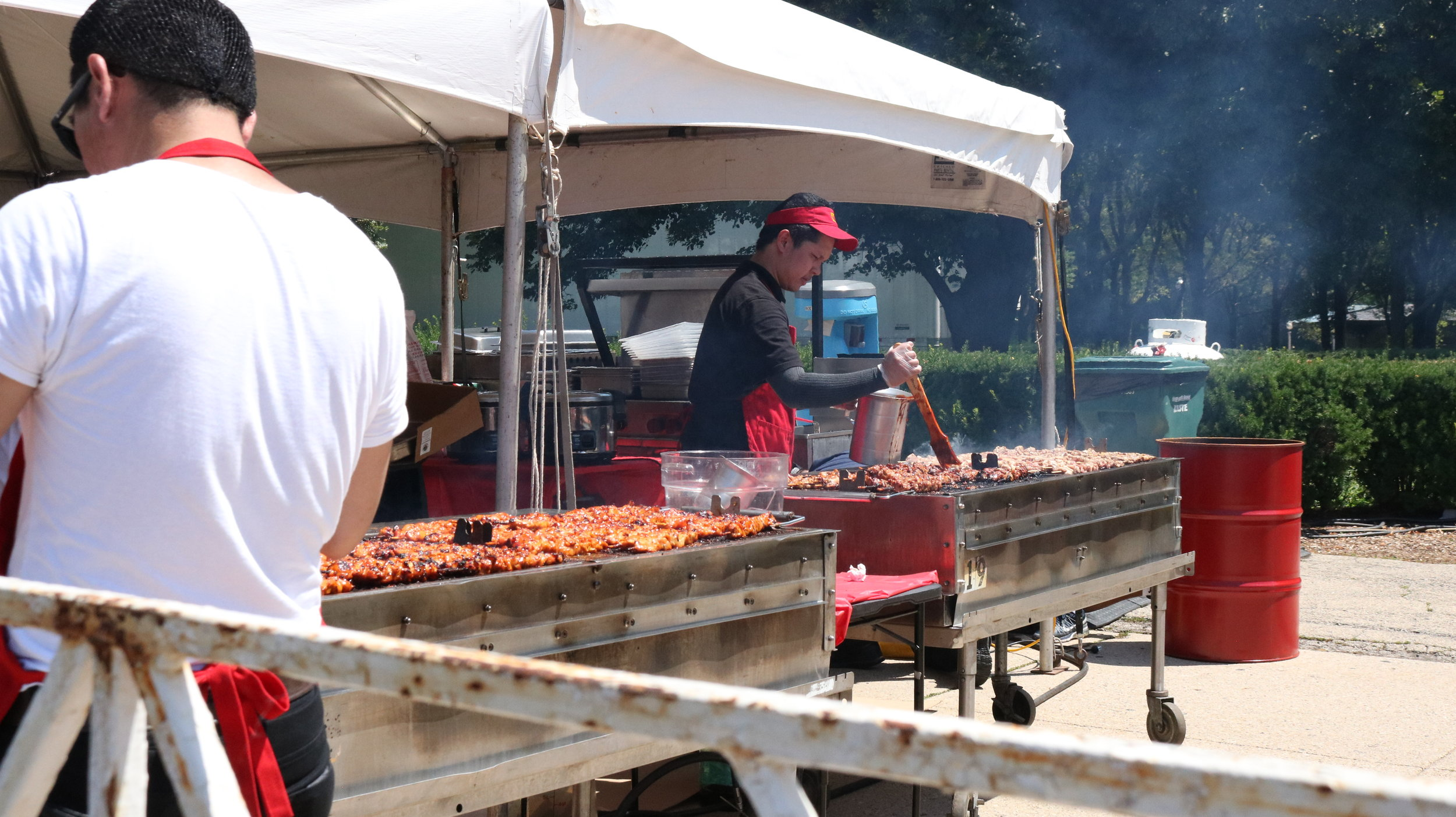 Grill City's Cook preparing Chicken BBQ on Stick during the first day of the Taste of Chicago. Photo by Clariza Adao