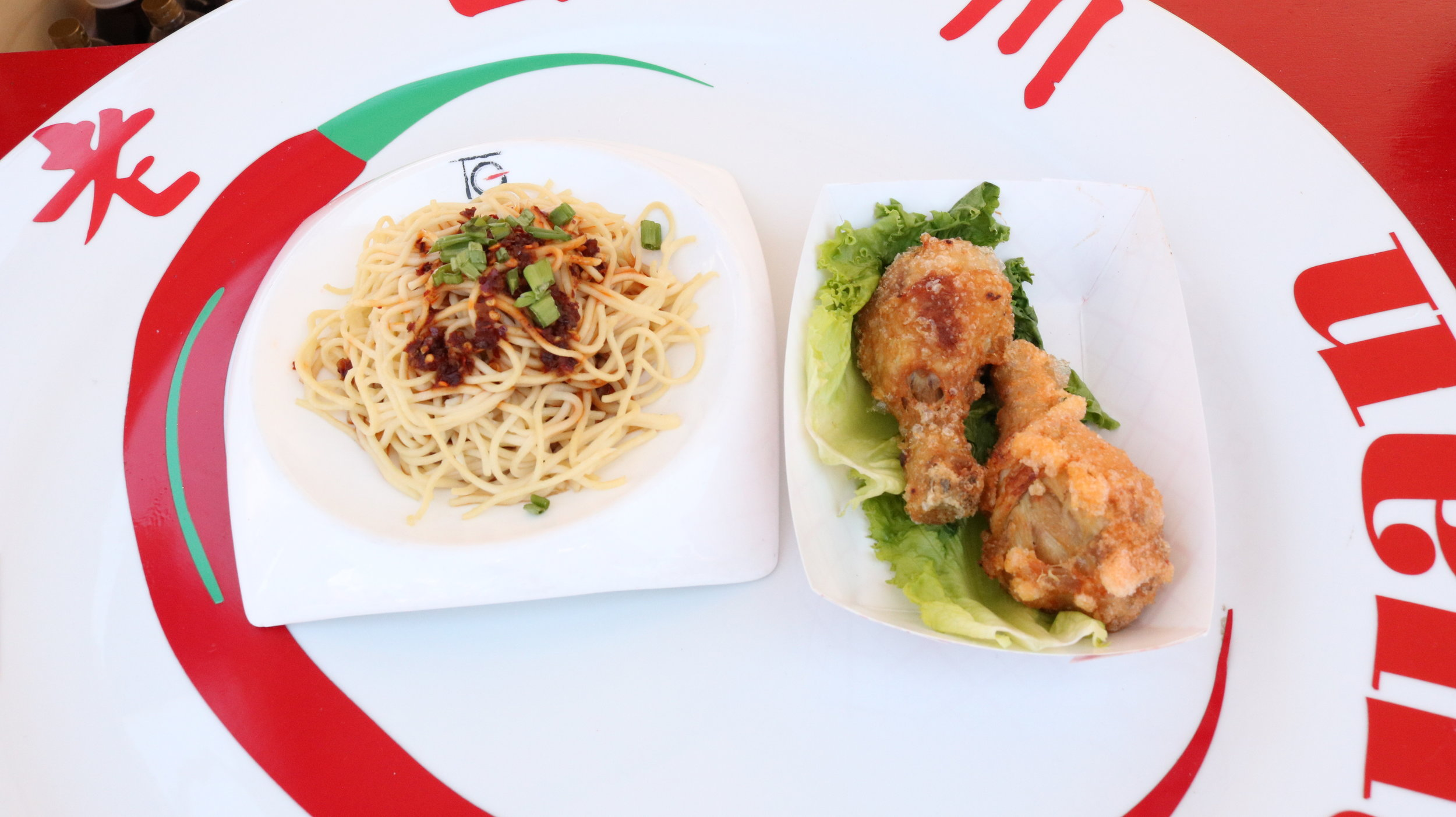 Lao Sze Chuan, one of the Asian restaurants at the Taste of Chicago, displays Cold Noodle Salad and Szechuan Style Chicken. Photo by Clariza Adao