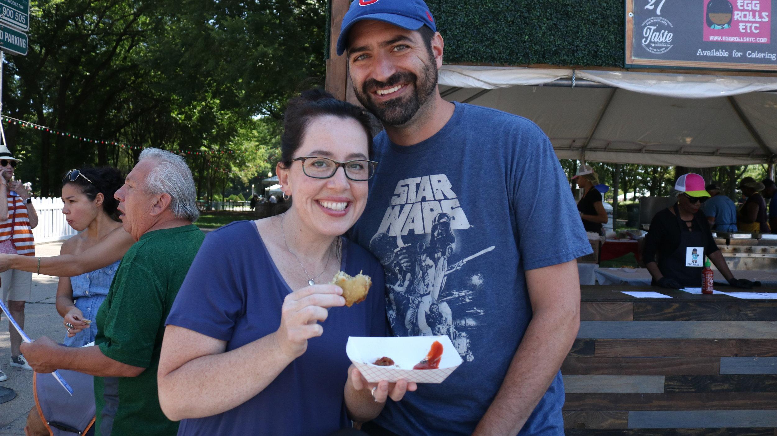 A couple enjoying a Mild Buffalo Chicken Egg Roll from Egg Roll Etc. Photo by Clariza Adao