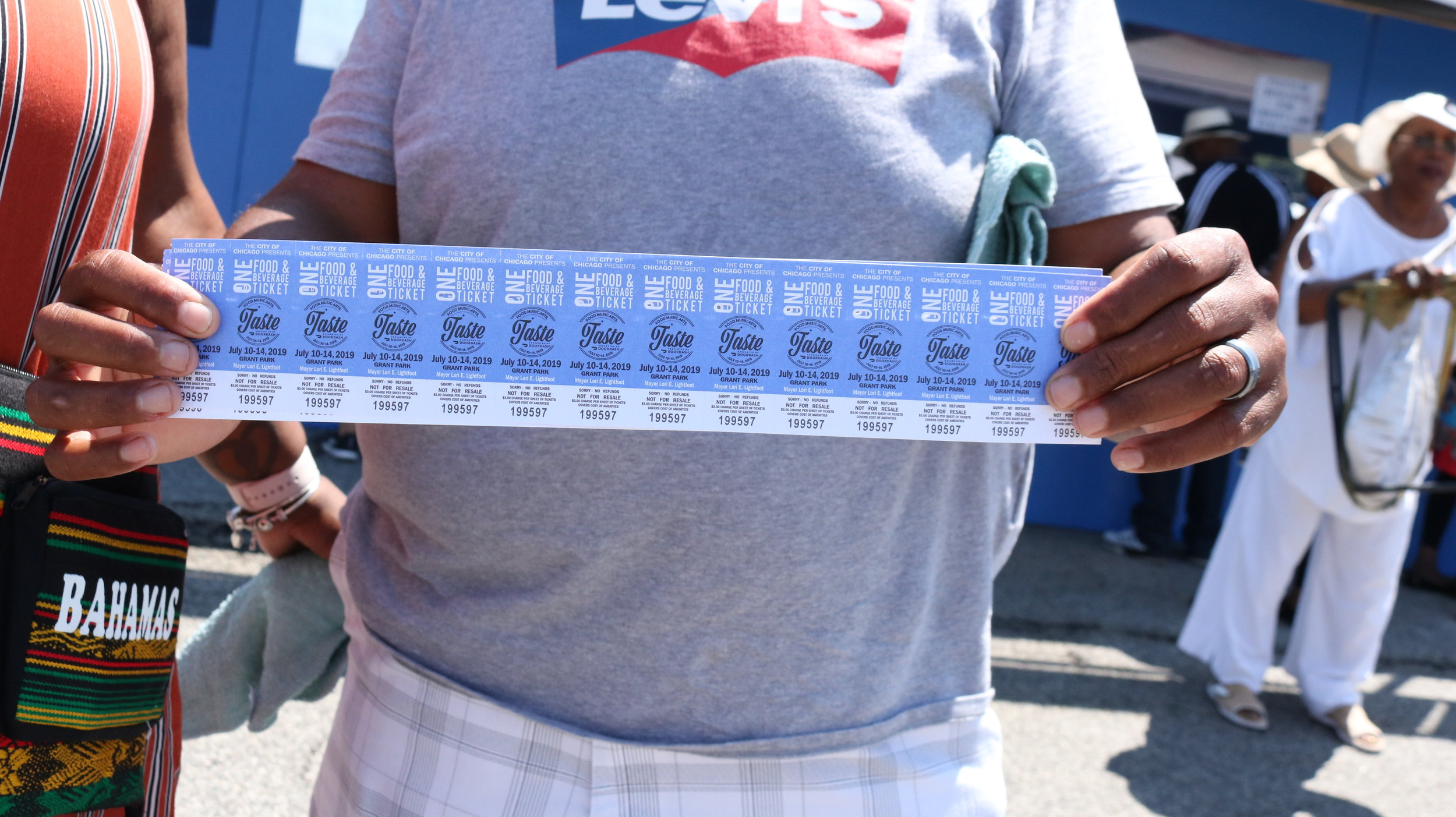 An attendee presenting his tickets at the Taste of Chicago. Photo by Clariza Adao