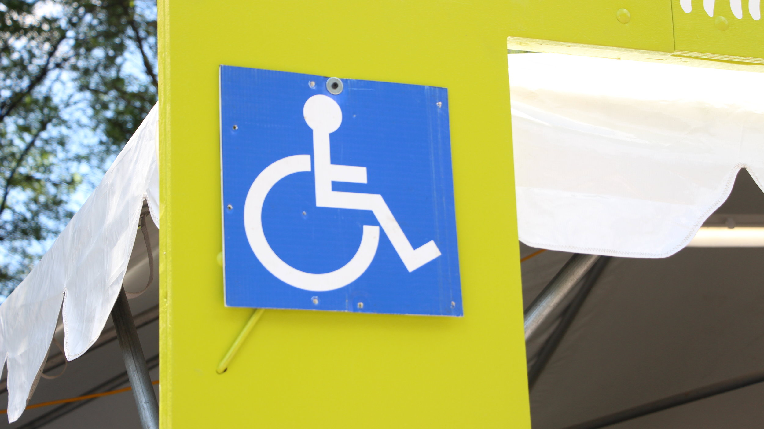 At the Taste of Chicago, these wheelchair-accessible signs are required for five-day vendors. Photo by Maia McDonald