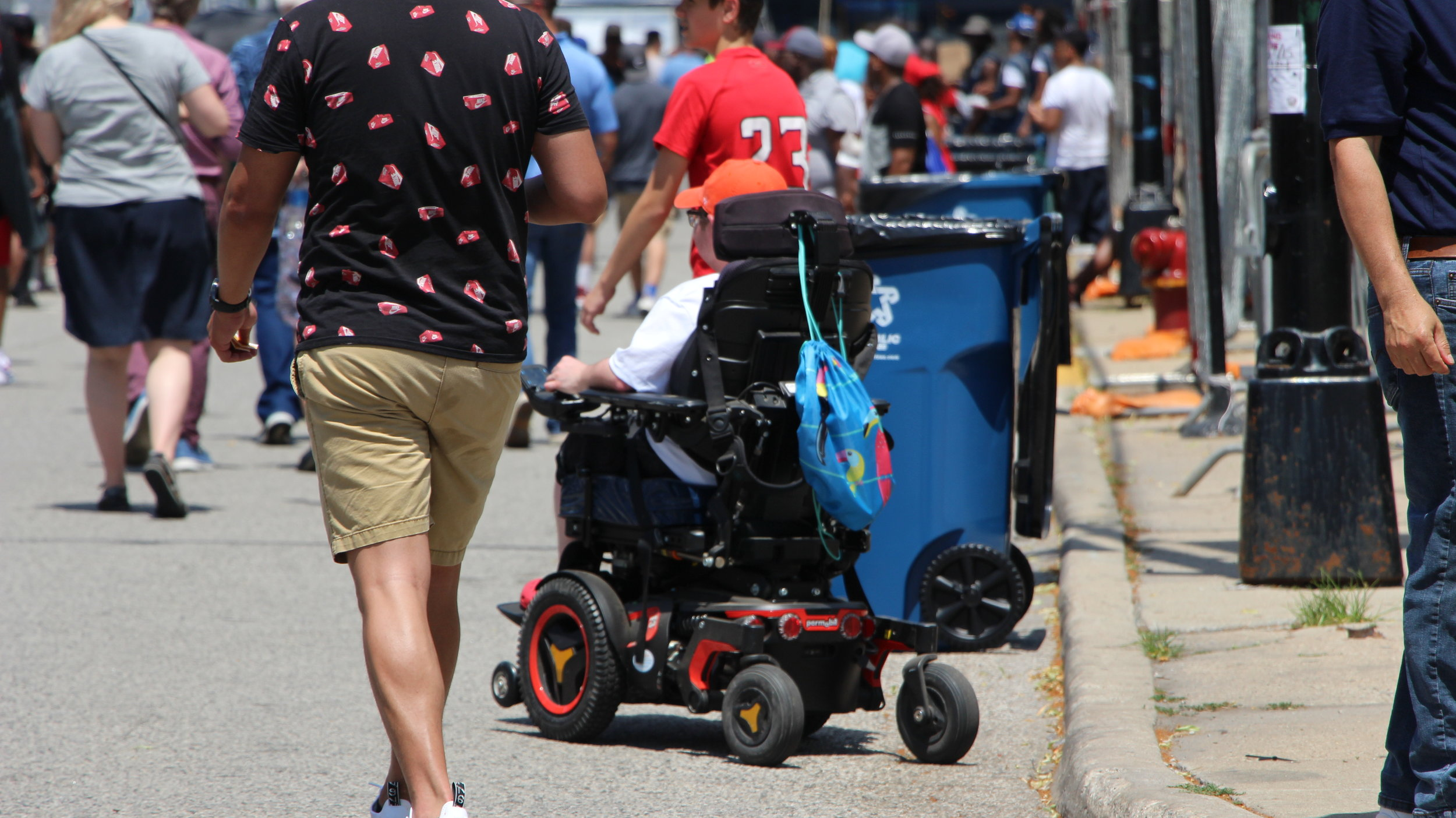 A wheelchair-user leaves the Taste of Chicago. Photo by Jerome Sanders