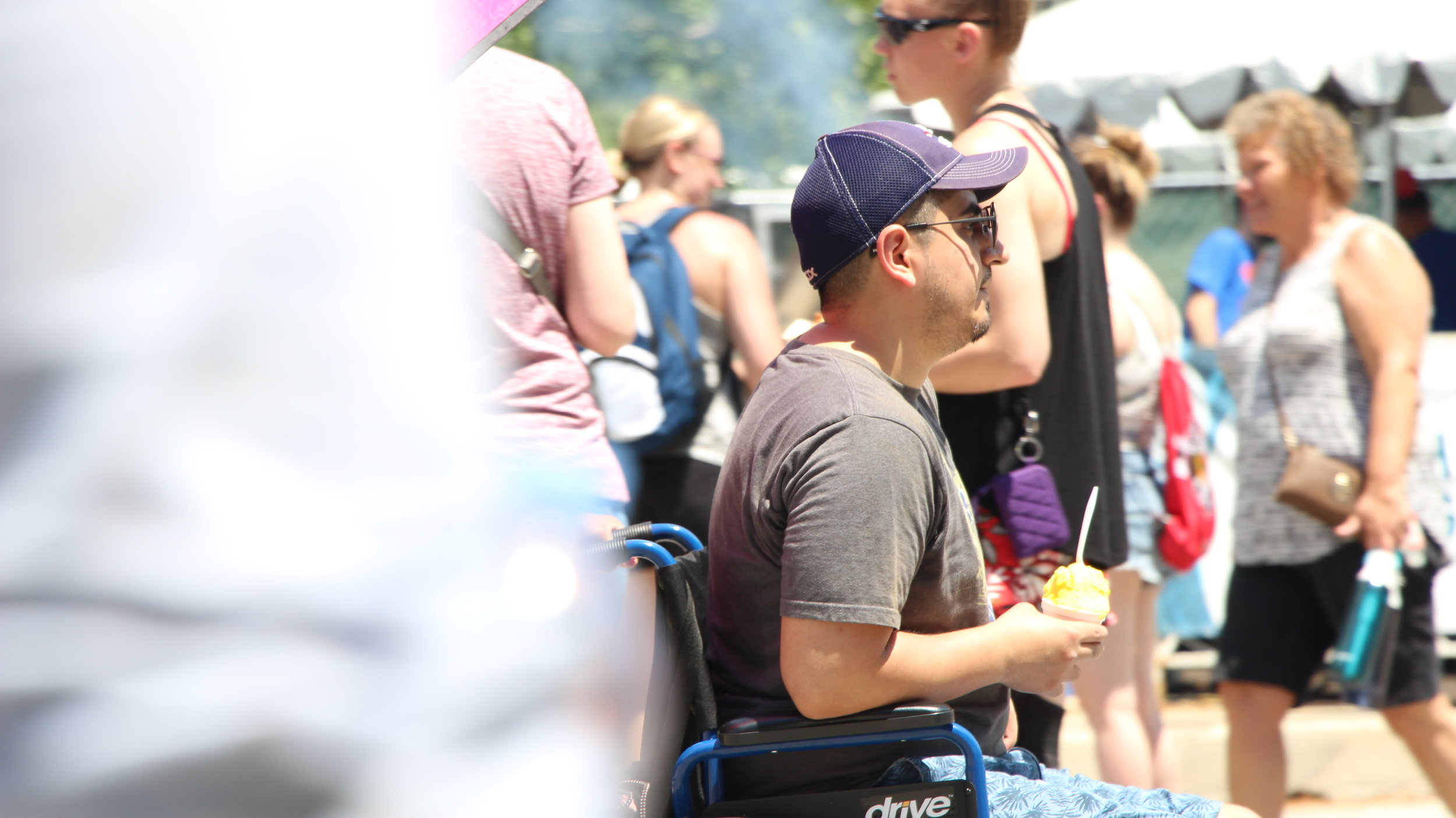 An attendee of the Taste enjoys the ice cream he bought from an accessible booth. Photo by Maia McDonald