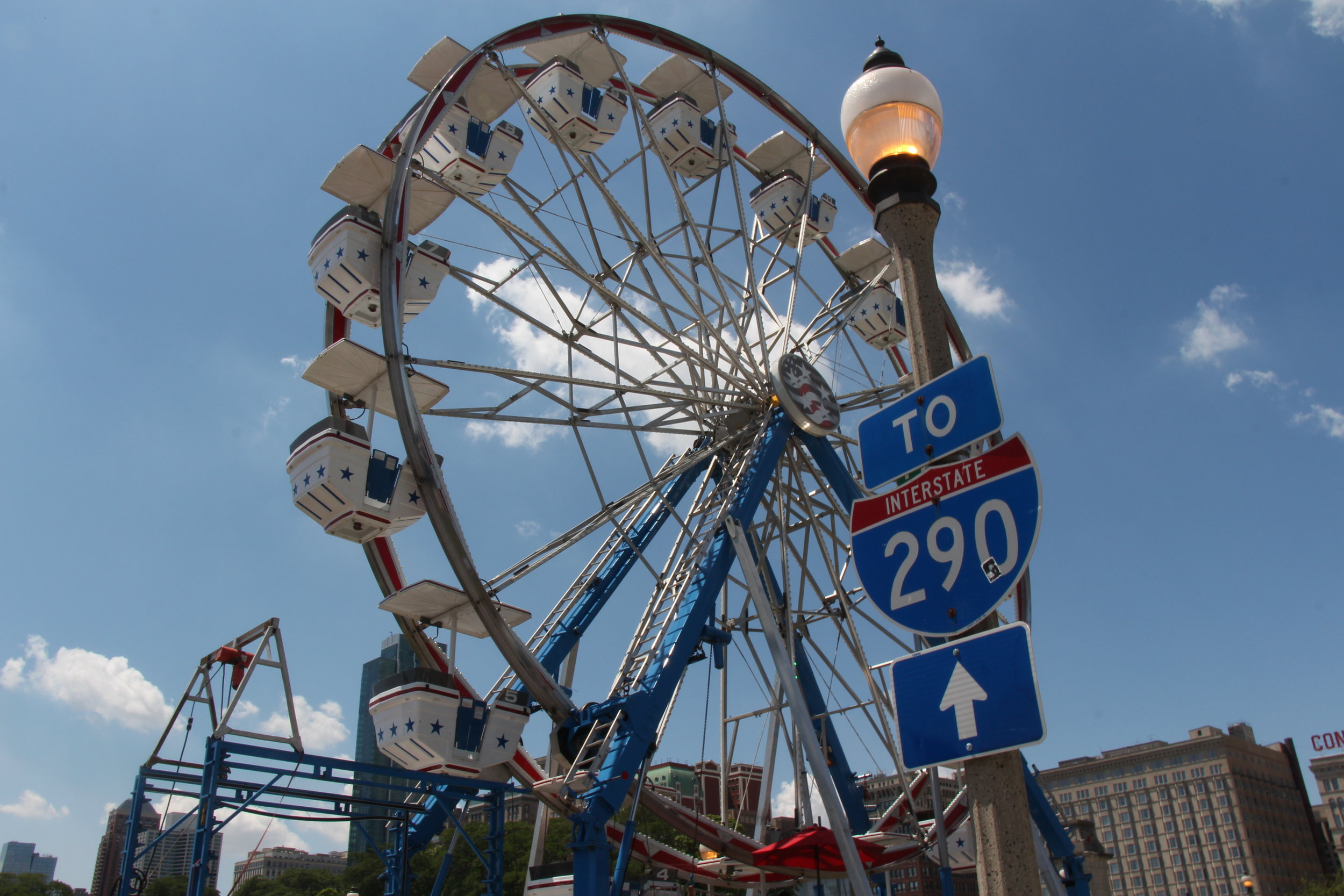 The ferris wheel emphasizing Chicago with the Ike Interstate Sign. Photo by Millie Johnson