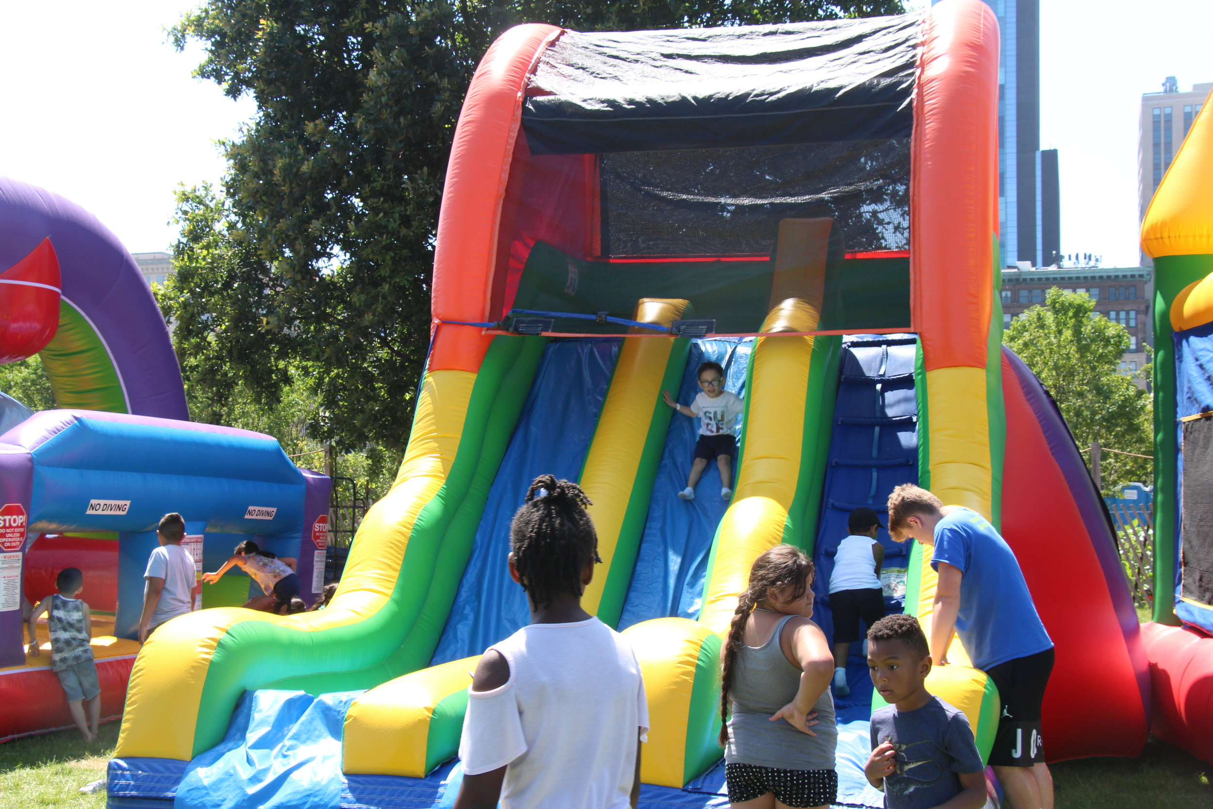 Kids enjoying a fun time on inflatables. Photo by Tyrese Pough