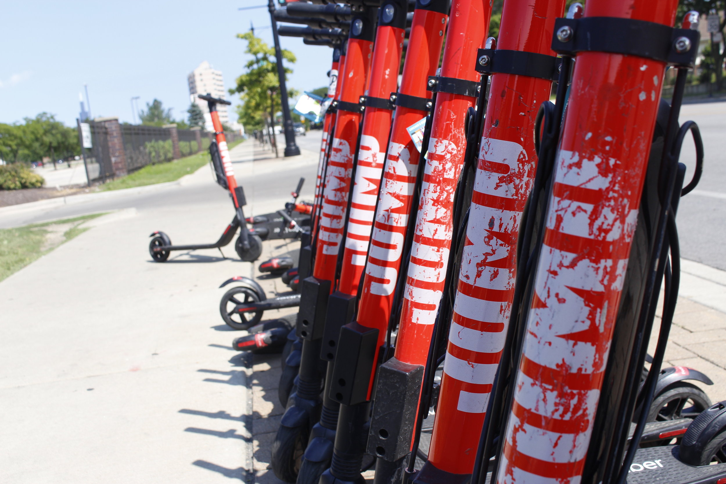 A close-up of parked E-Scooters located on West Roosevelt Ave and South Homan Ave. Photo by Clariza Adao