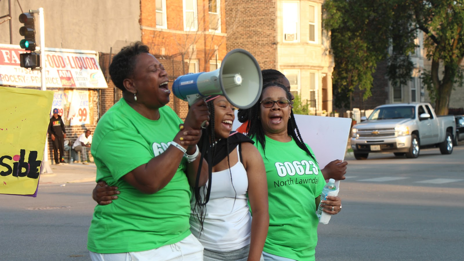A Lawndale Resident expressing North Lawndale resident leading the march with powerful words. Photo by Tyrese Pough