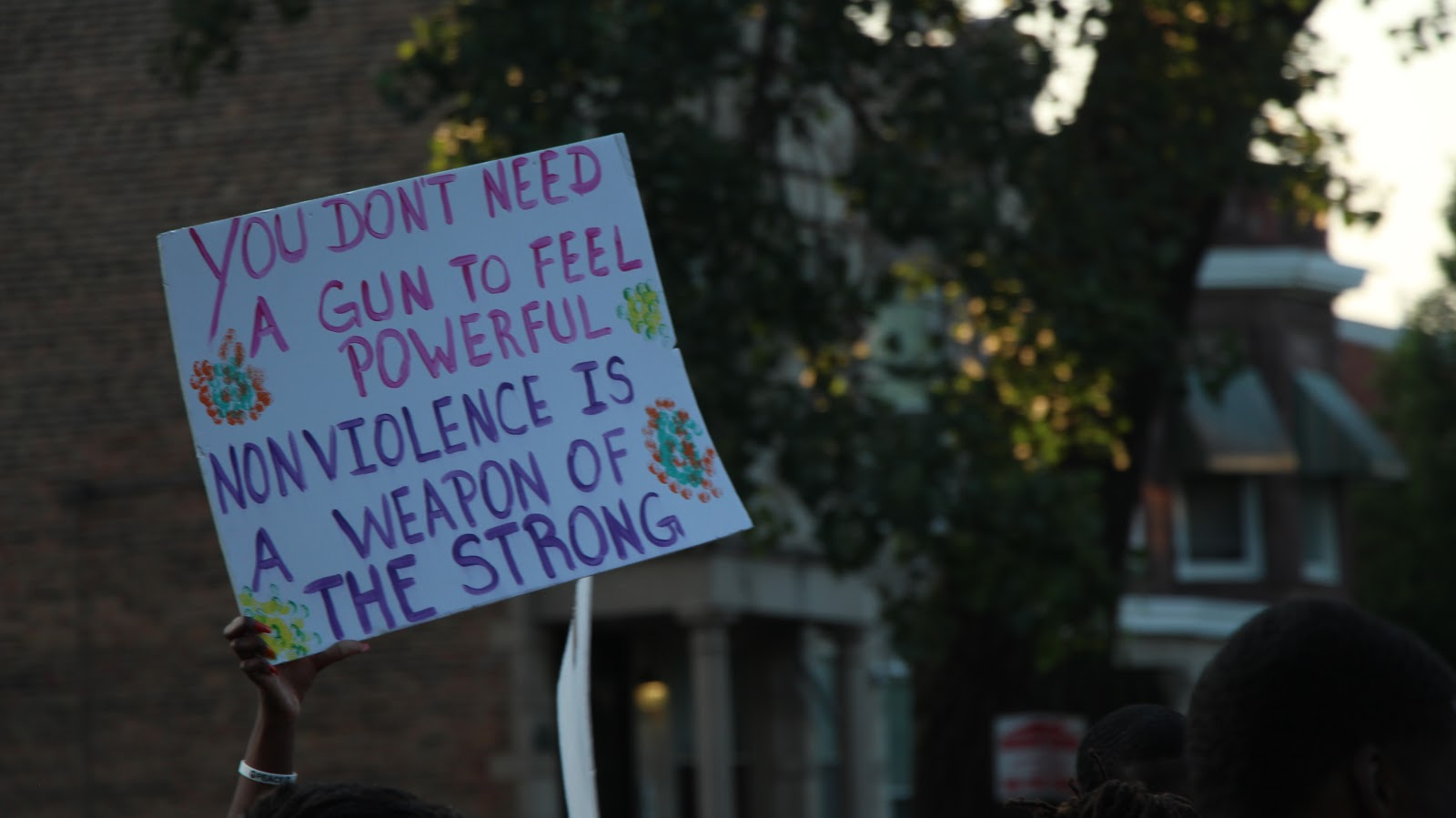 Anti-violence sign at 60632 Peace Gathering. Photo by Tyrese Pough