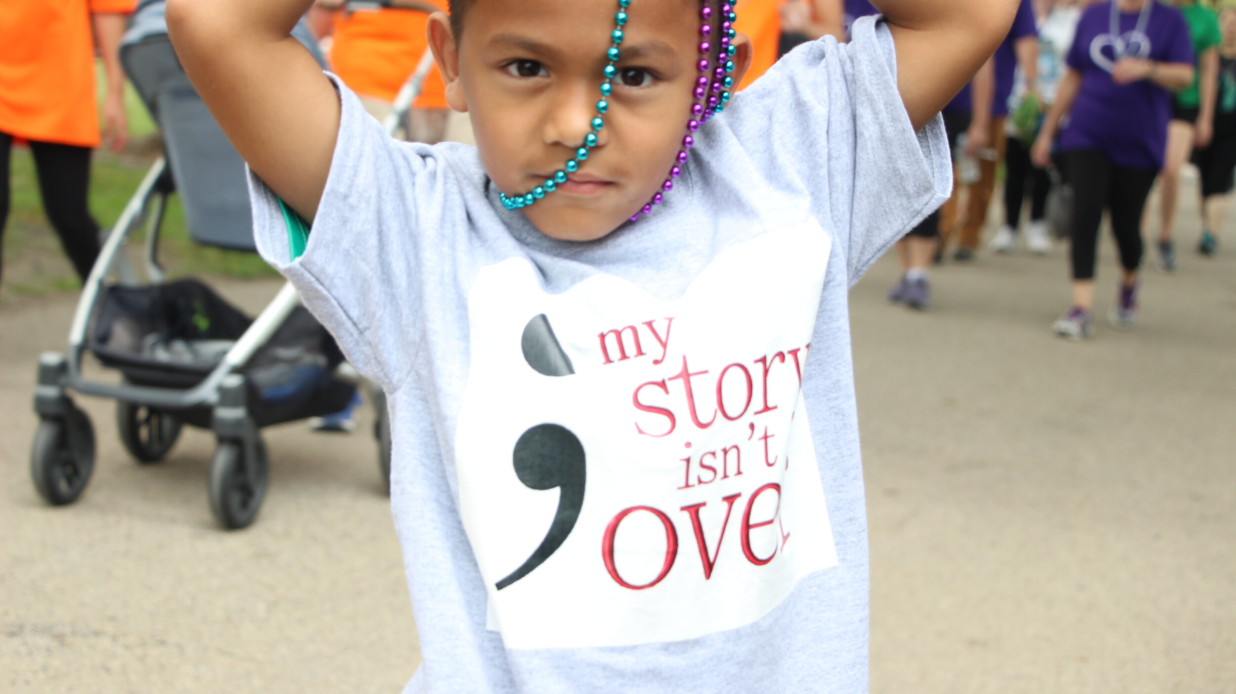 The 7-year-old, who came with his family members, was wearing purple Honor Beads, symbolizing the loss of a relative or friend.