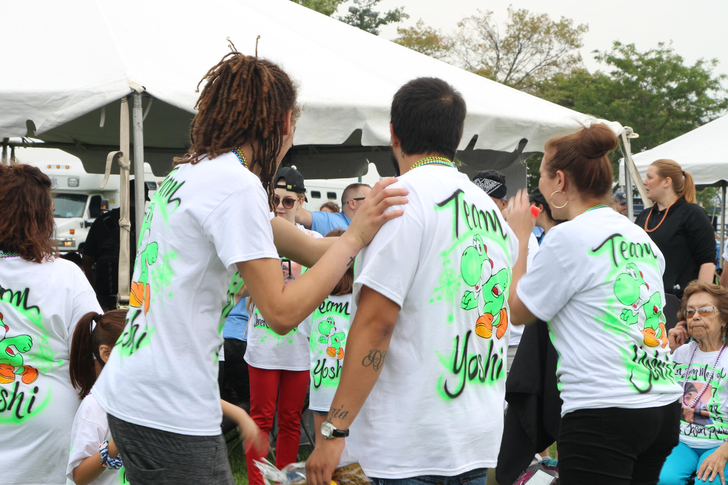 Team Yoshi met up to honor a lost loved one in matching customized T-Shirts.