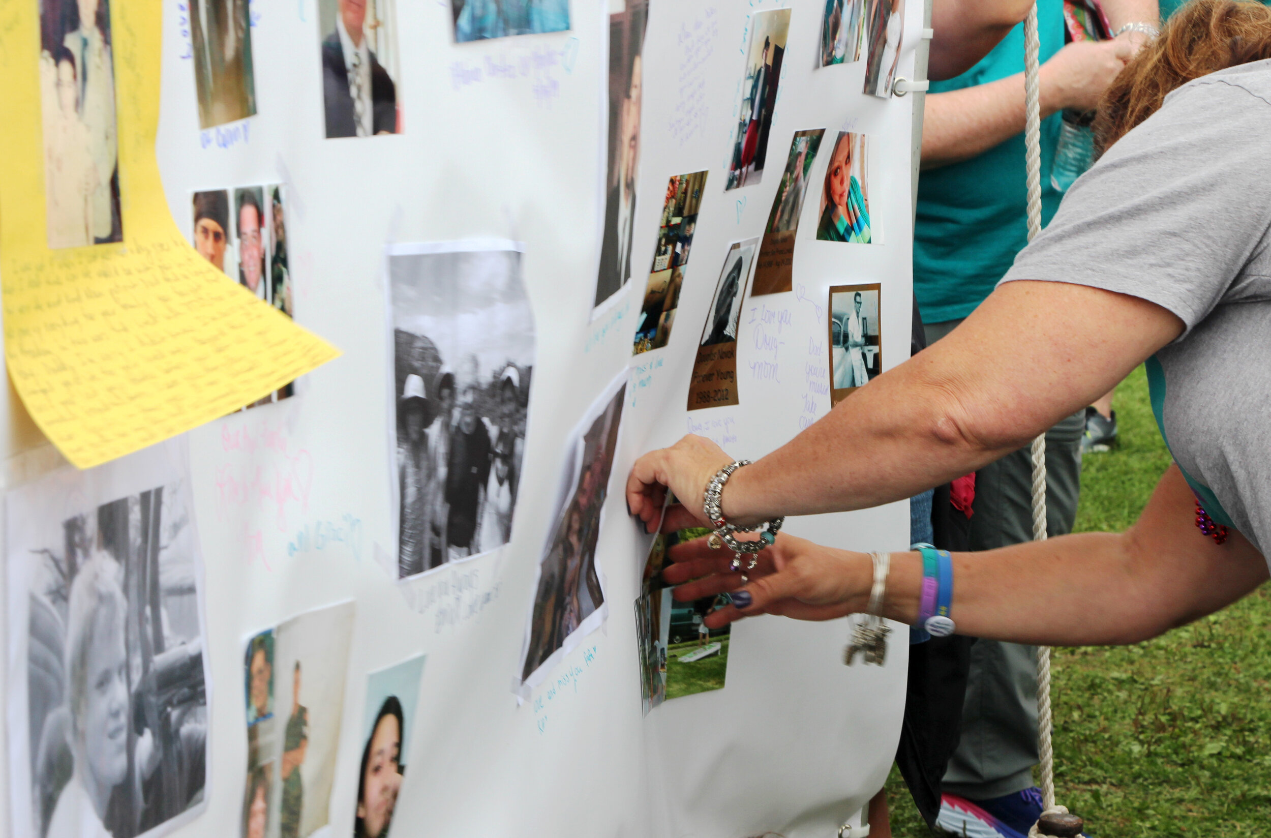 Photos and personal messages on the Memorial Wall honor friends and family member lost to suicide.