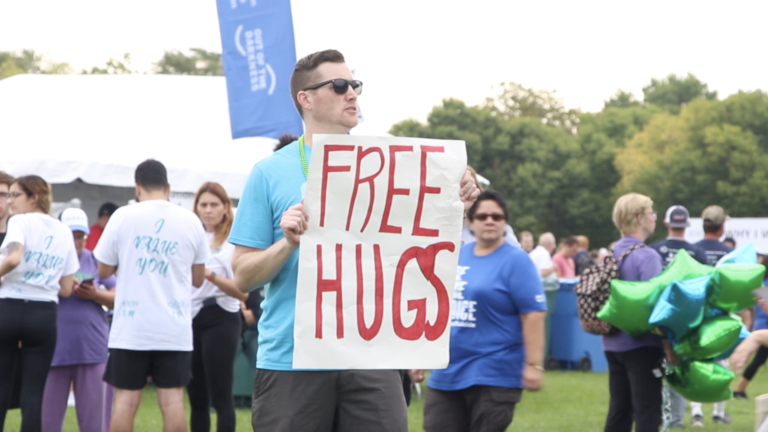 A volunteer offering free hugs at the event.