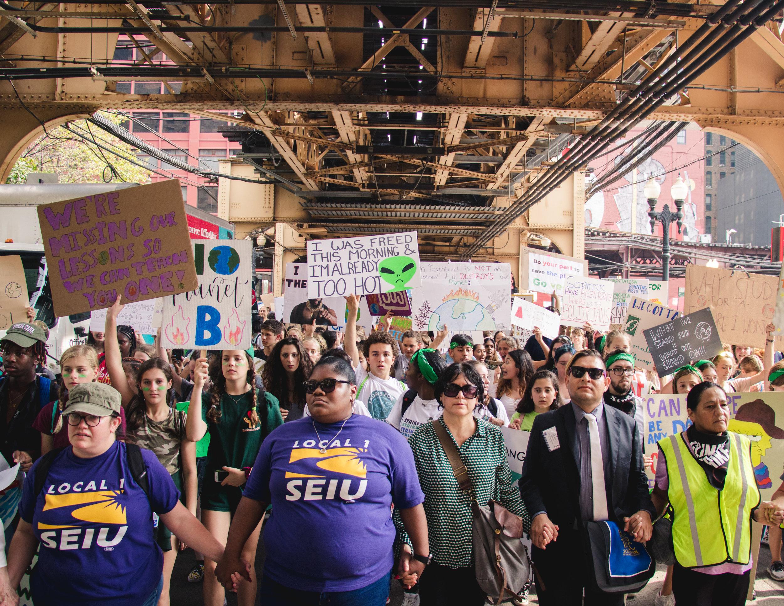 Organizers walking underneath the city's raised train tracks.