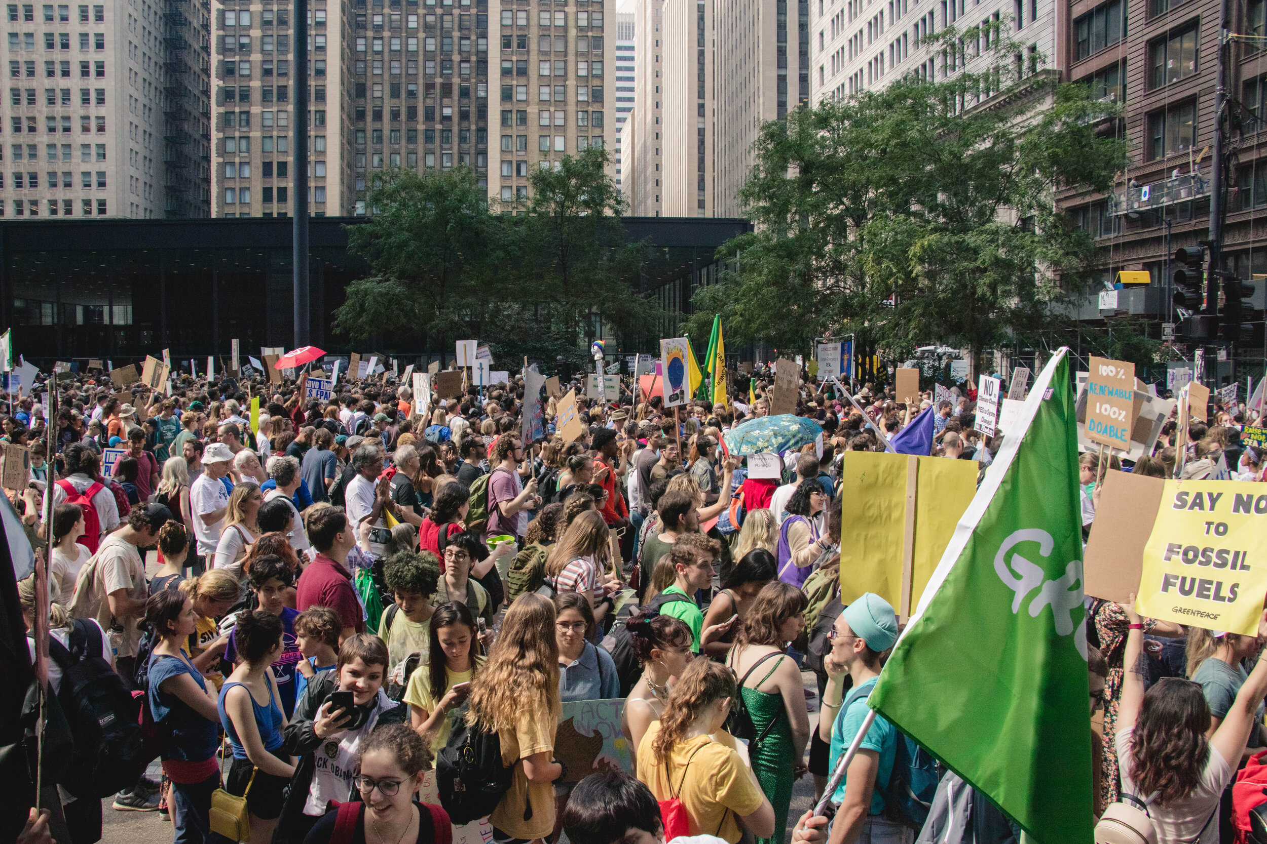 After marching for over a mile, the bulk of the organizers amassed at Federal Plaza. They crowded over a set of benches where youth leaders stood and read their speeches.
