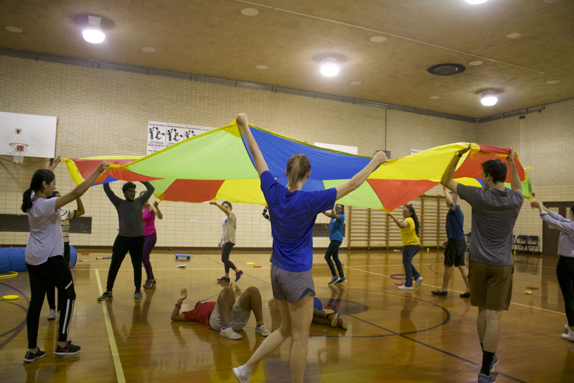 A KEEN Chicago session at Loyola Park winds down with parachute fun with the athletes.
