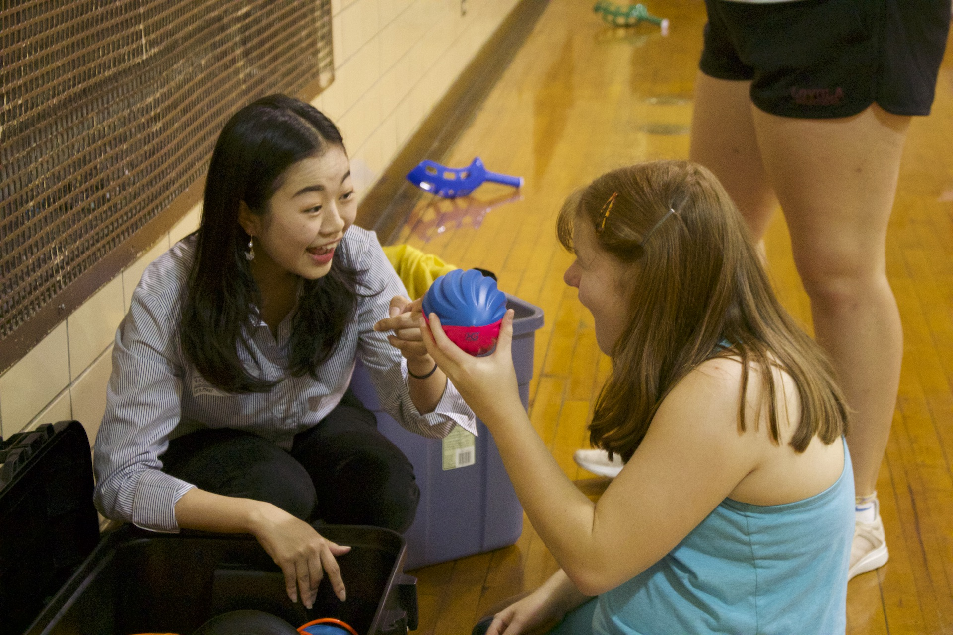 A KEEN Chicago volunteer helps a KEEN athlete pick out an activity for the day.