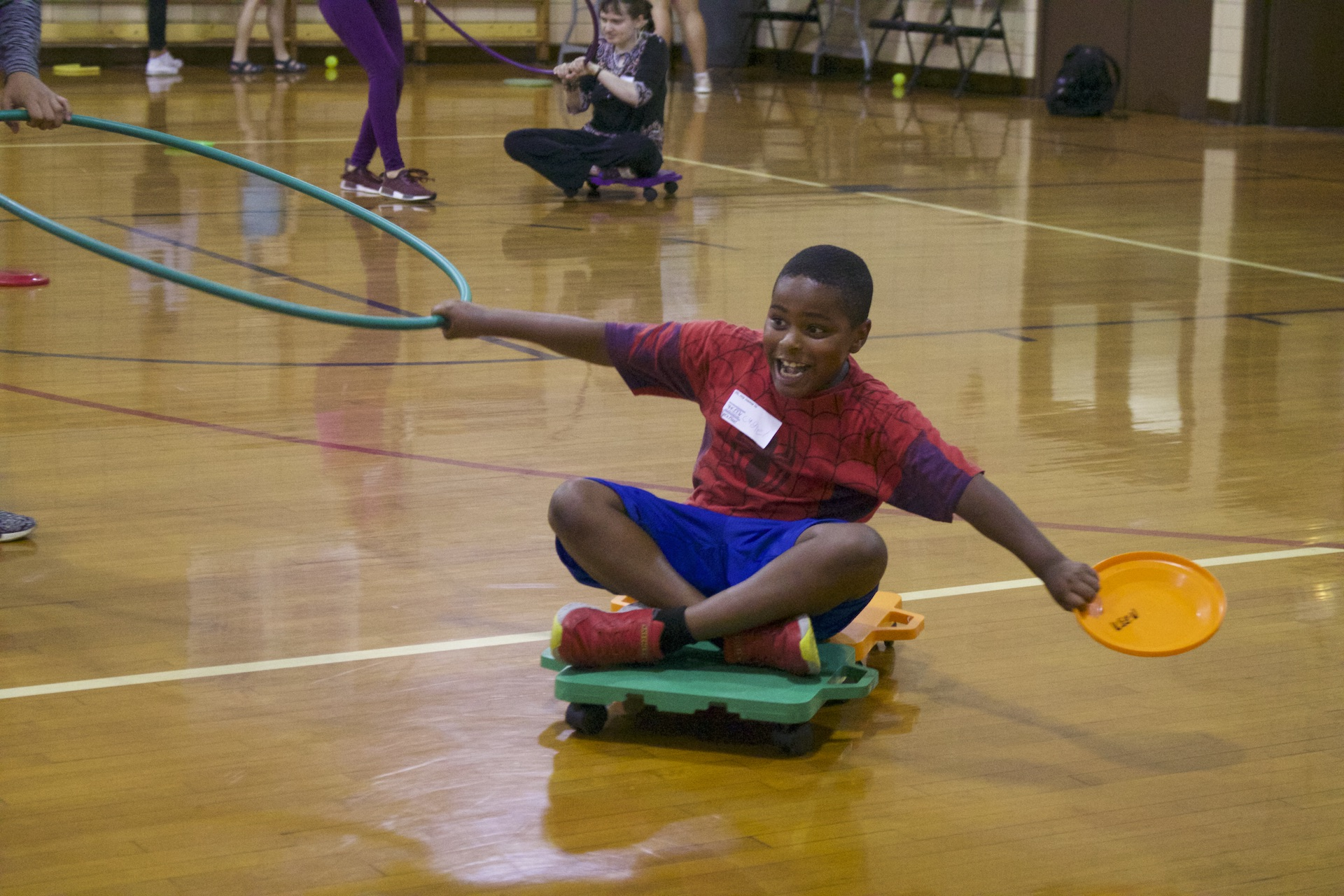 A KEEN athlete enjoys playtime with a volunteer during the KEEN Sports program at Loyola Park.