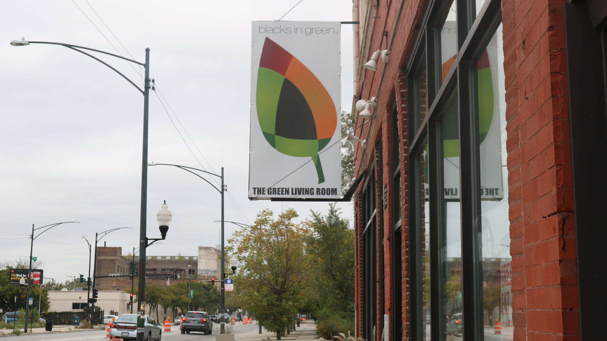 """The banner hanging outside symbolizes """"Blacks In Green""""'s dedication to environmental health."""