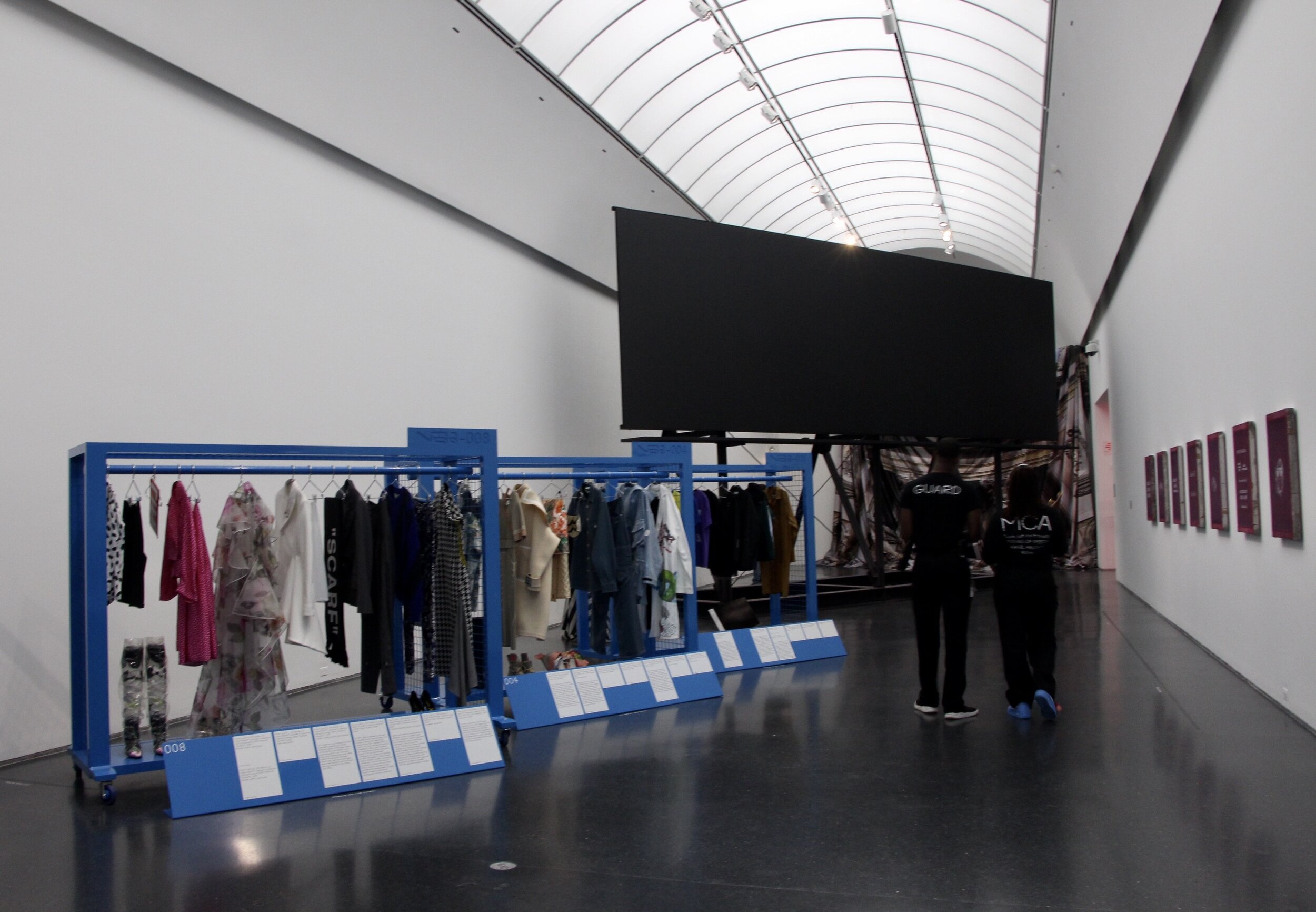 Inside Chicago's Museum of Contemporary Art, seven rooms helped showcase Virgil Abloh's 'Figures of Speech' exhibit. At the end of one room, azure blue racks with 'Off-White' and Louis Vuitton garments and an all-black billboard were on display.