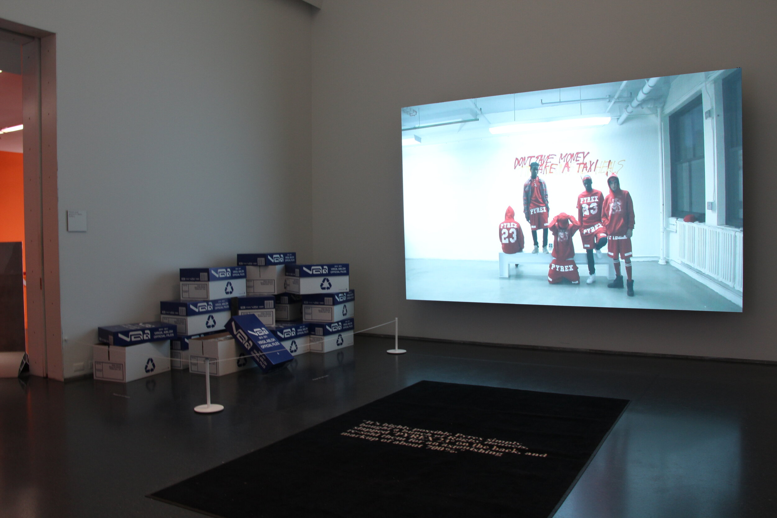 "The first room of 10 displayed a film titled ""A Team with No Sport,"" one of Virgil's first fashion projects. Virgil used old rugby flannels and printed ""Pyrex 23"" on the back then re-sold them with a profit of 700%."