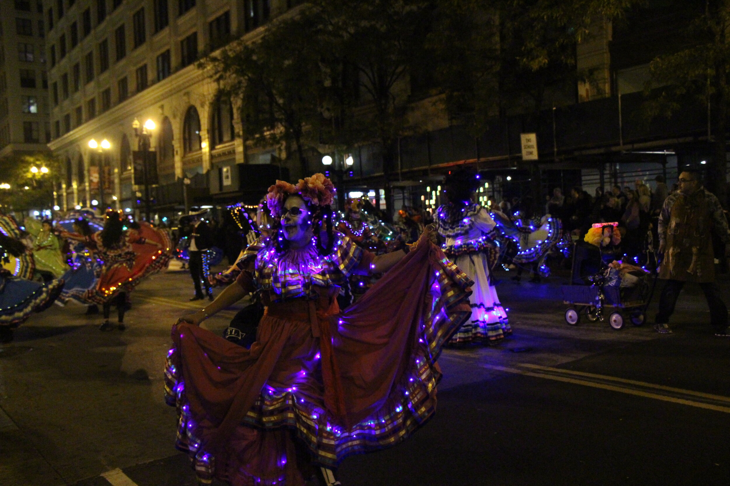 Performers twirling their way across the Art in the Dark parade