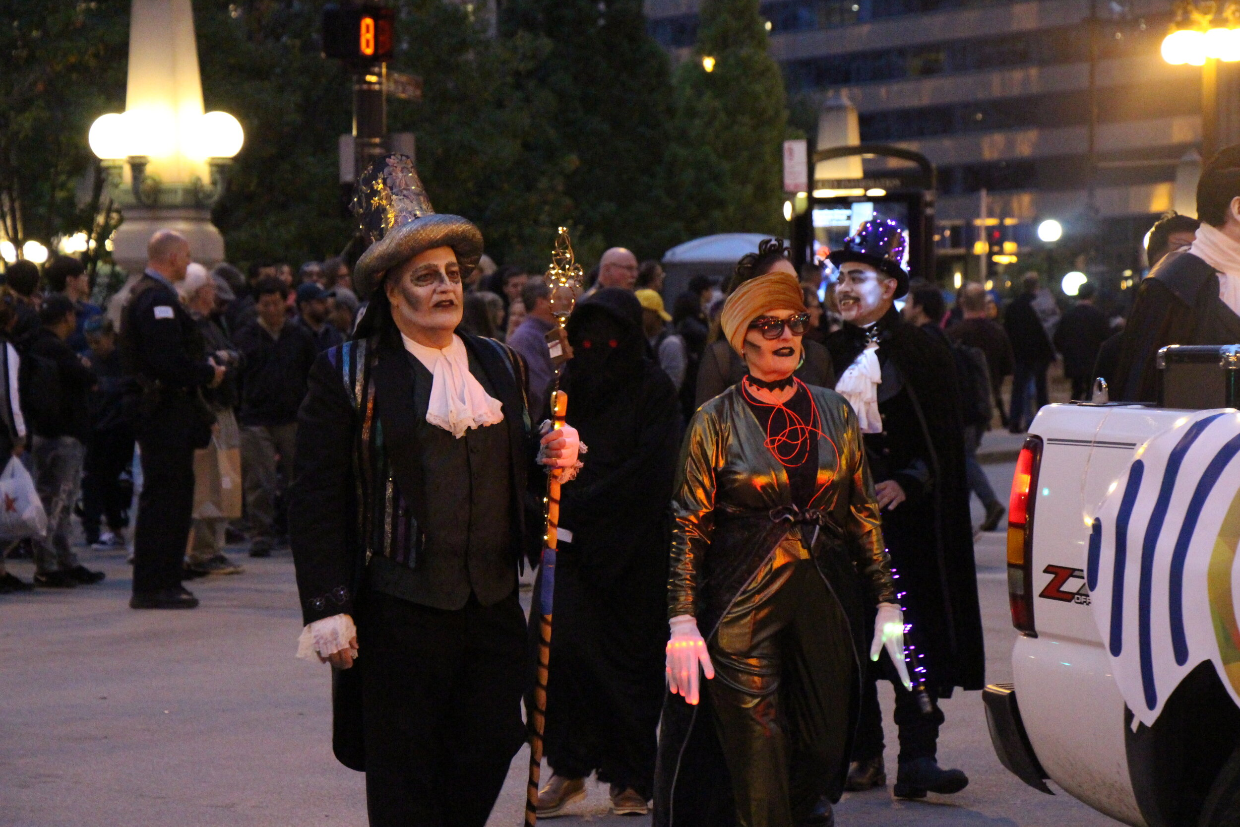 Performers dressed in spooky costumes at the parade.