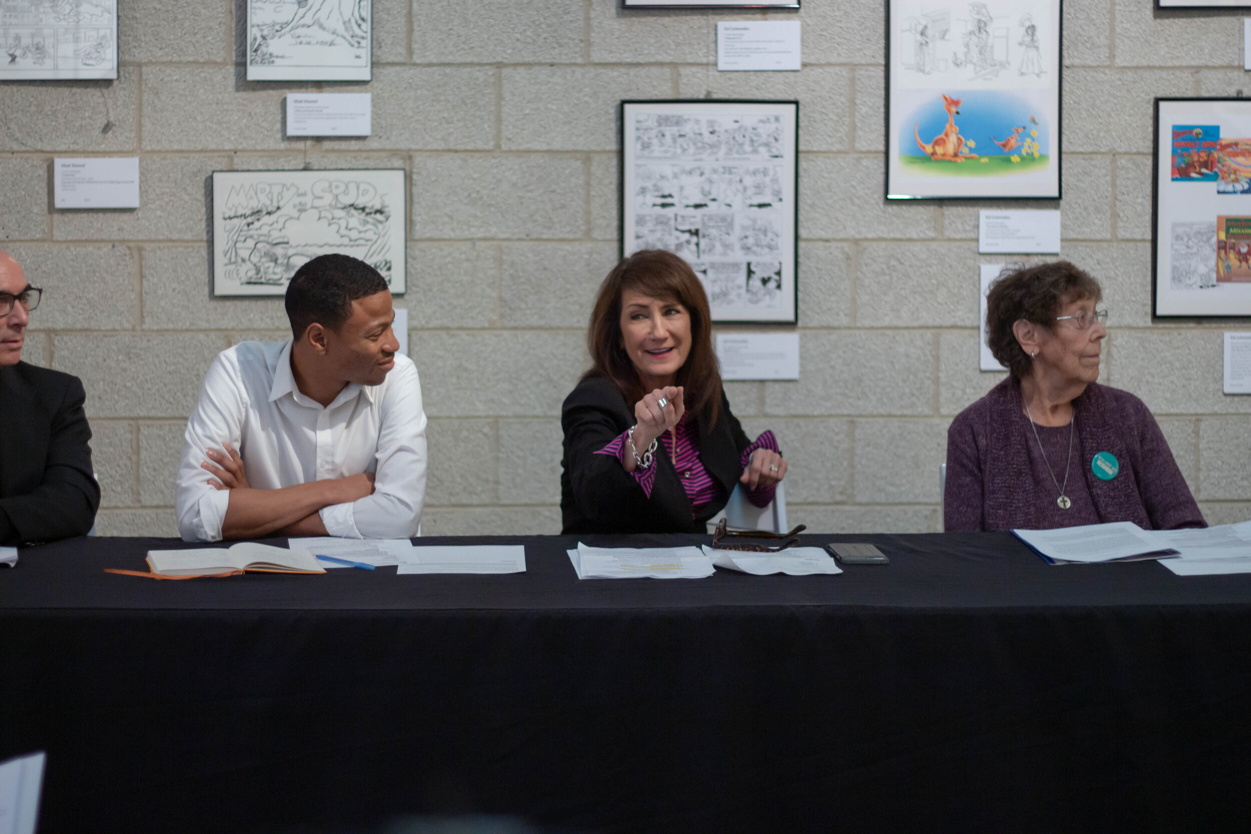 (Left to right) Robert Emmons Jr., Marie Newman and JoAnn Persch along with other speakers share the stage to talk about racism in Chicago. Emmons and Newman are both congressional candidates for the first and third districts respectively.