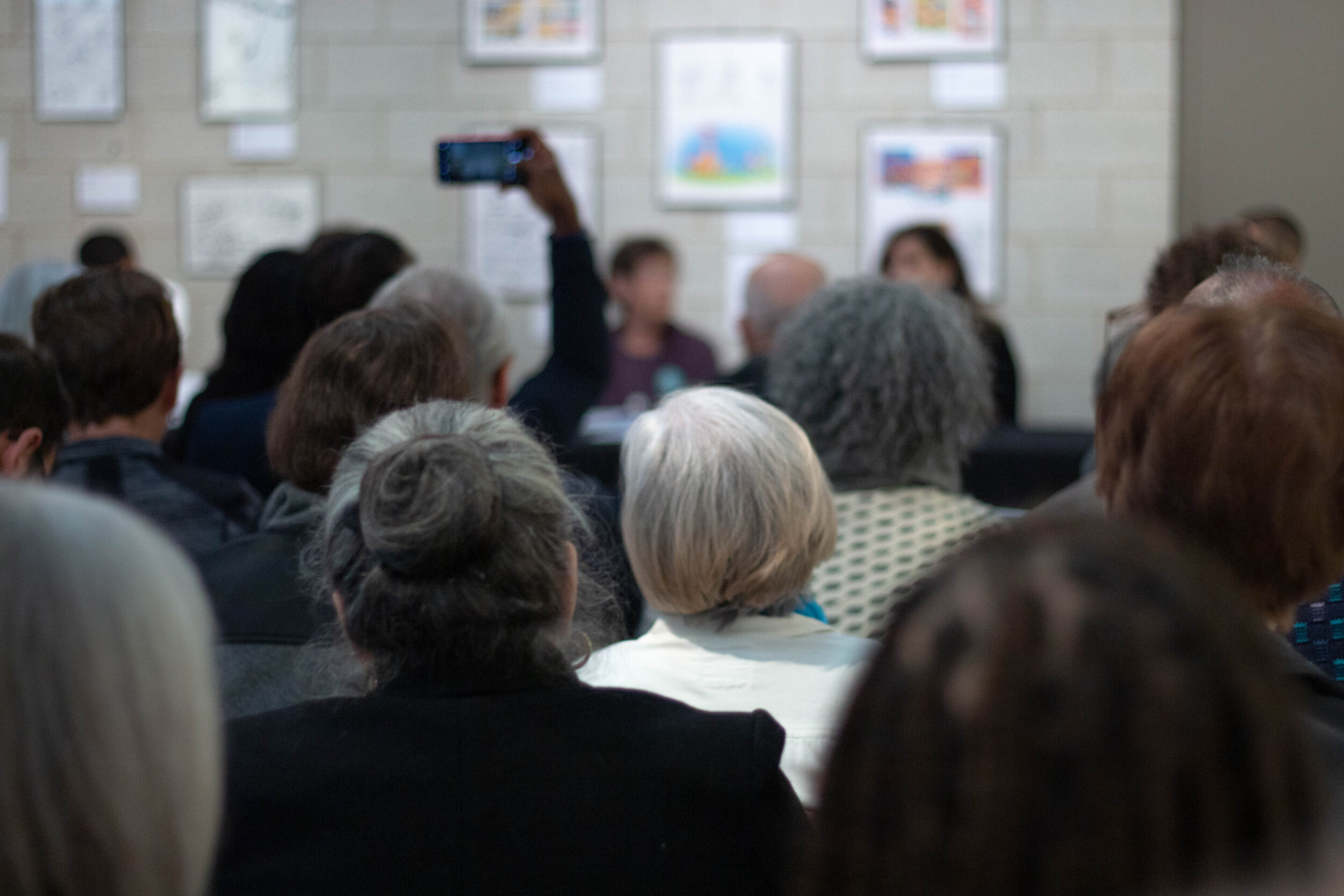 A crowd of of mostly middle aged people filled the empty seats of the Simmerling Gallery and listen to the panelist discuss the issues affecting their communities.