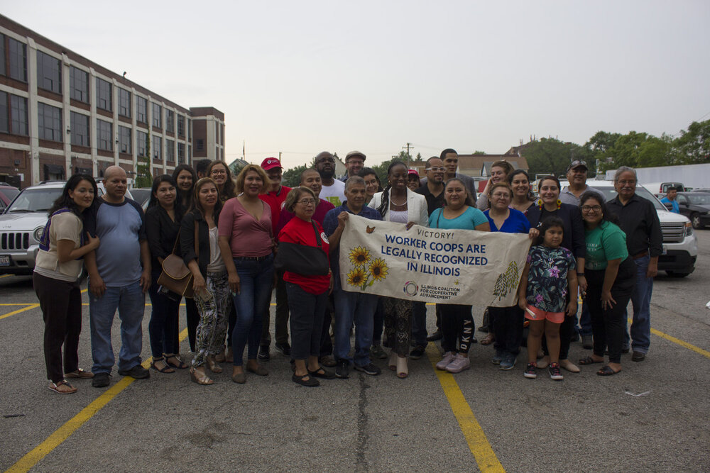 Legislators celebrate the passing of the LWCAA in August, 2019 (Source:  Chicago Food Policy )