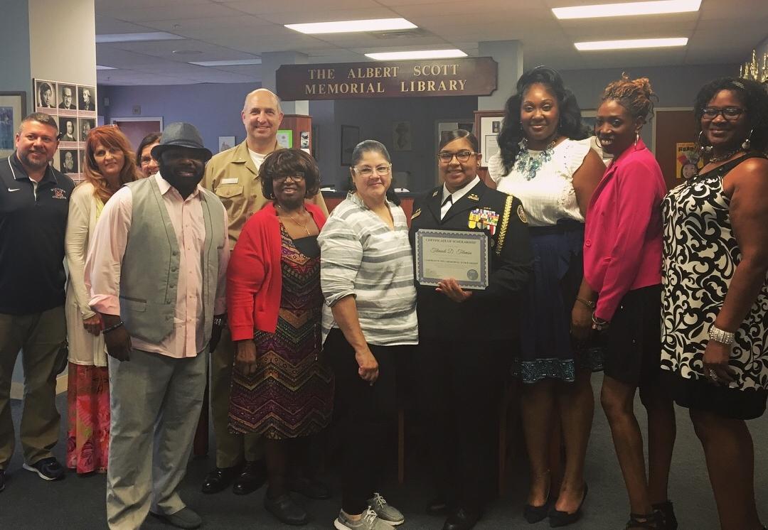 Scholarship Winner Telmadi Telemin with WNY Maritime Charter School Staff
