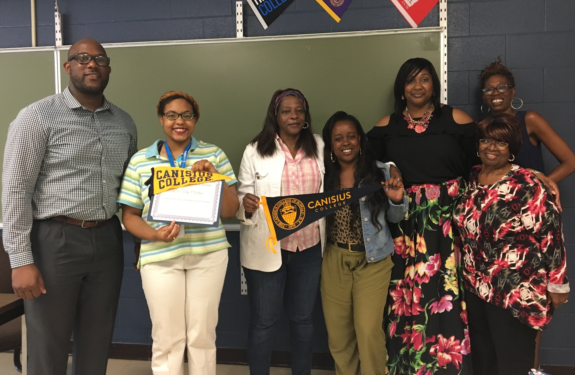 Scholarship Winner DesTiny Overton with Buffalo Prep Staff
