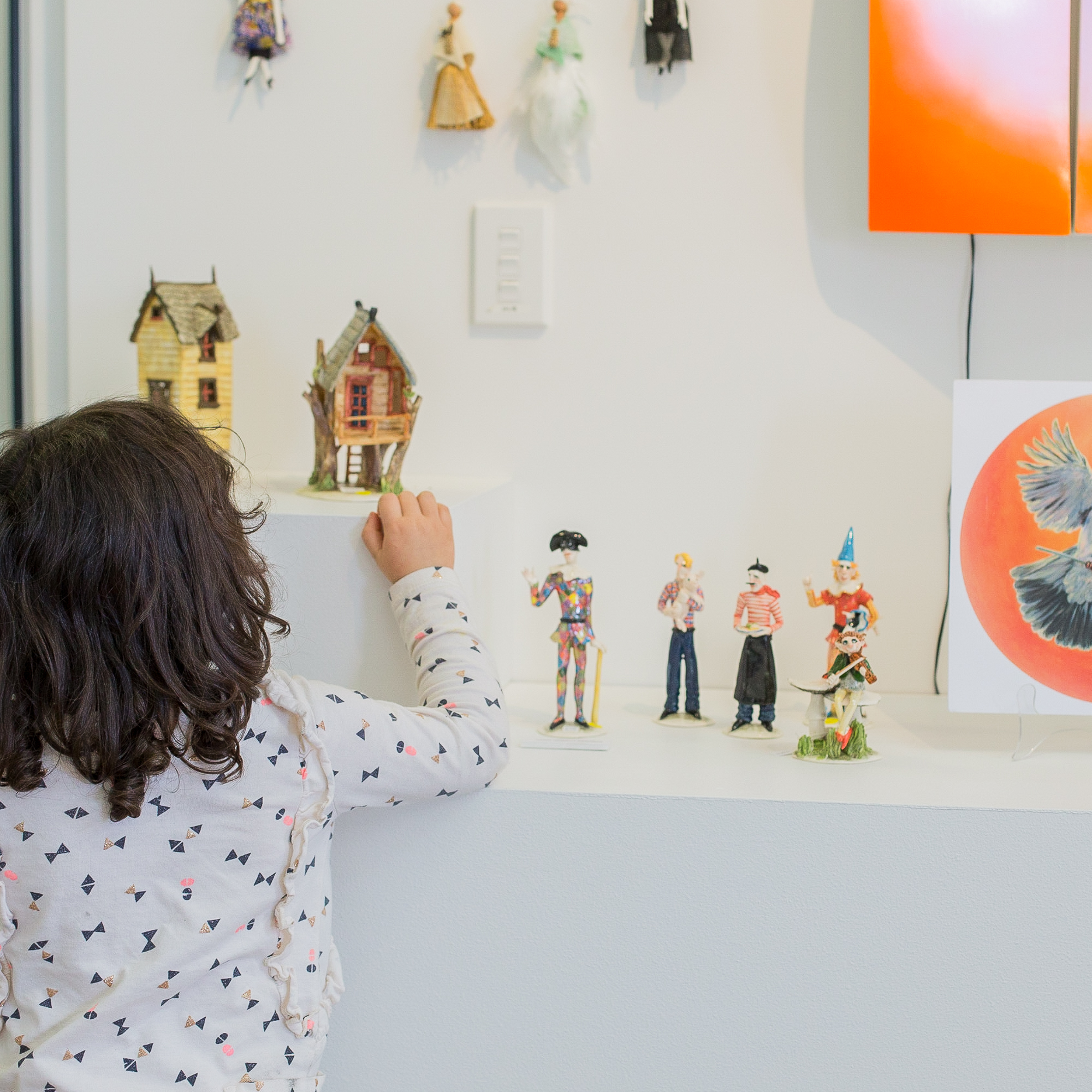 Girl viewing miniatures in gallery