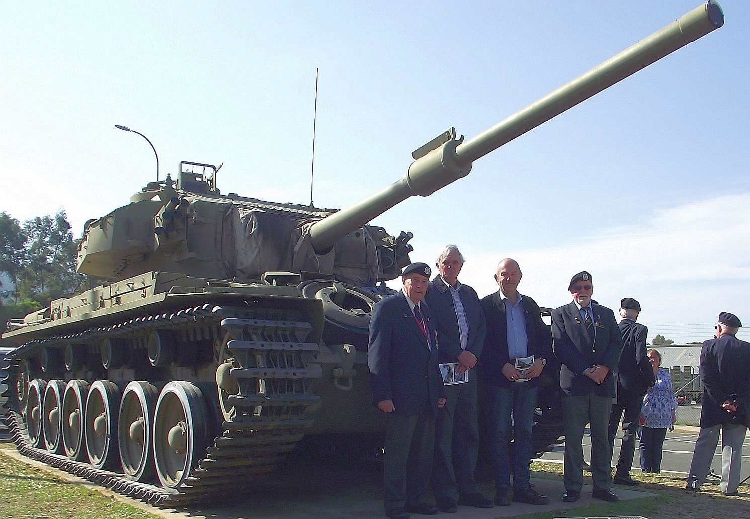 Members of the Association standing in front of the Memorial Tank following the Service.