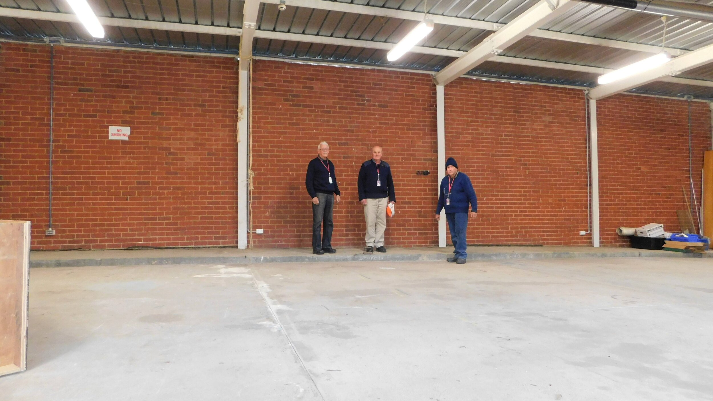 Before we started work. Doug Hunter, Robert Dawe and Graham Garvie standing against the wall where the prefabricated fixtures are to be installed.