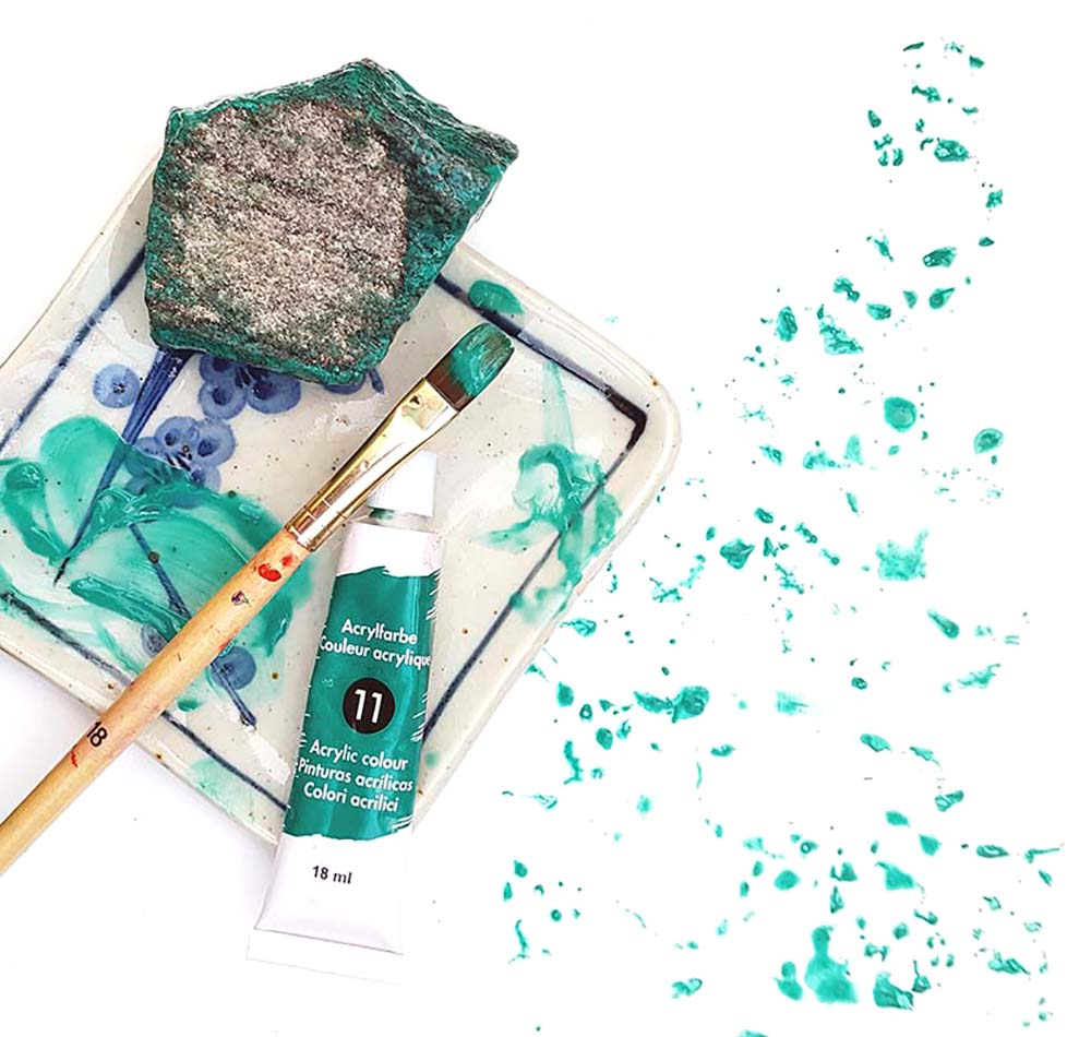 Acrylic mark-making in teal