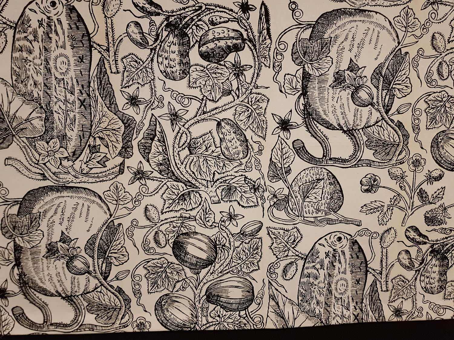 The rich etching of fruit and leaves. I'm guessing this could be William Morris?