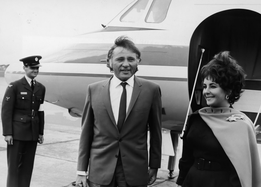 Elizabeth Taylor, actress and her fifth and sixth husband, actor Richard Burton in front of their jet after arriving at RAF Abingdon. The HS 125 jet was a birthday present for Elizabeth Taylor from Richard Burton