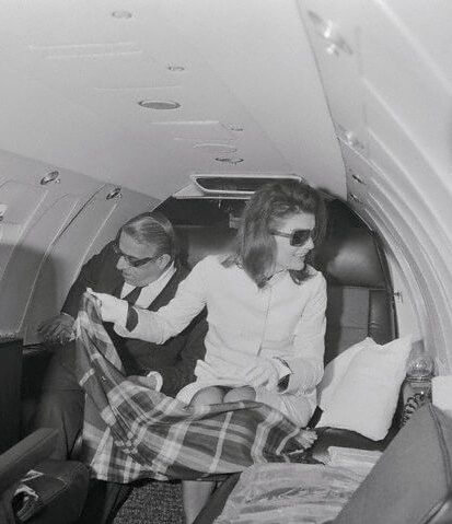 Aristotle and Jackie Onassis aboard their private jet to Athens