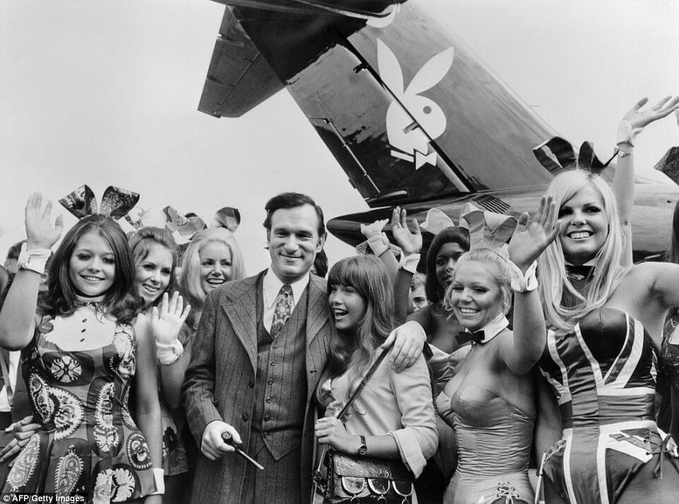Hef with his then-girlfriend, actress Barbara Benton, and other playmates arriving at Paris Le Bourget airport