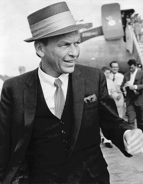 Frank Sinatra. In the background Dean Martin can be seen siging autographs.