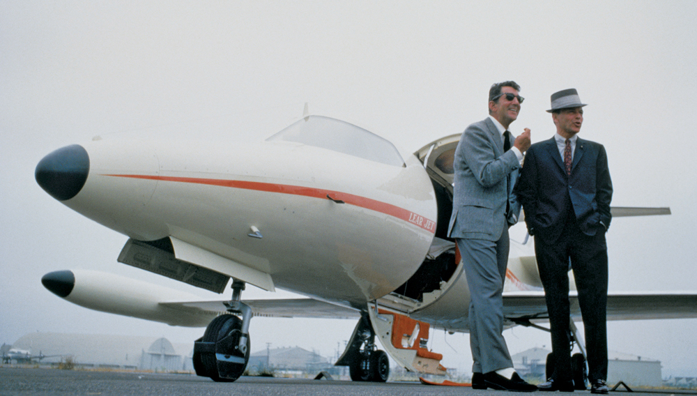 The Chairman of the Board standing next to his Learjet 23 with Dean Martin. Rumour has it the aircraft engines ran on Scotch 'n' Soda and not jet fuel.